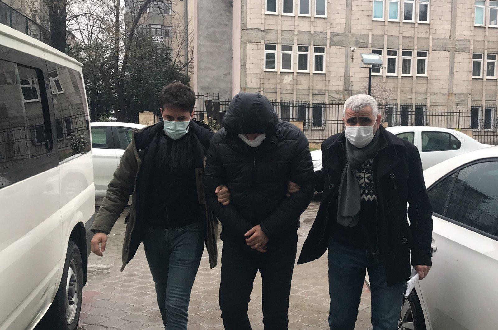 A FETÖ member is taken into custody in Samsun, Turkey, Feb.16, 2021. (AA)