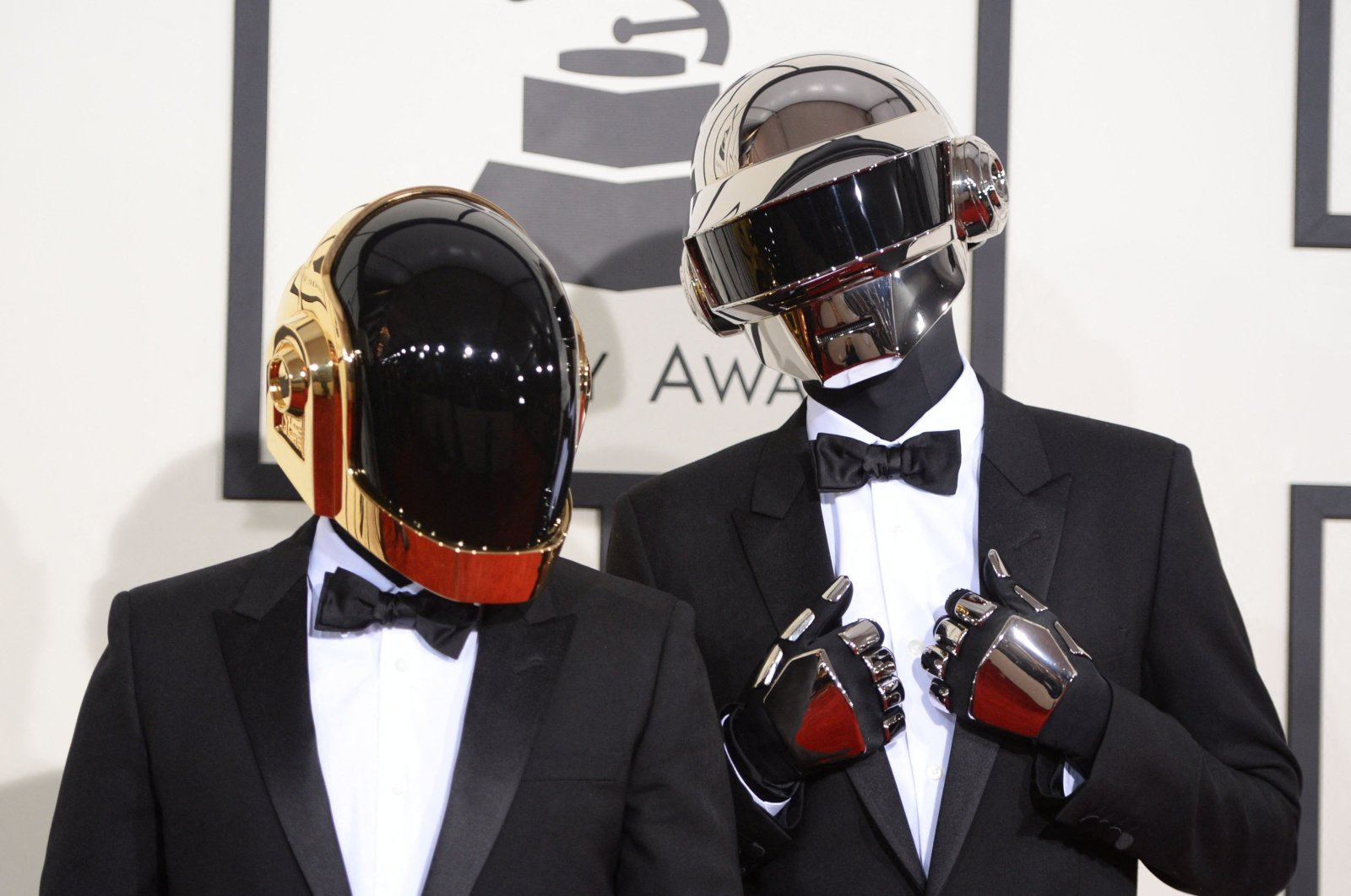 Daft Punk arrive on the red carpet for the 56th Grammy Awards at the Staples Center in Los Angeles, California, on Jan. 26, 2014. (AFP)