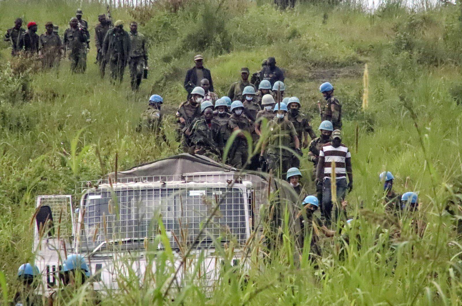 United Nations peacekeepers remove bodies from an area near where a U.N. convoy was attacked and the Italian ambassador to Congo killed, in Nyiragongo, North Kivu province, Congo, Monday, Feb. 22, 2021. (AP Photo)