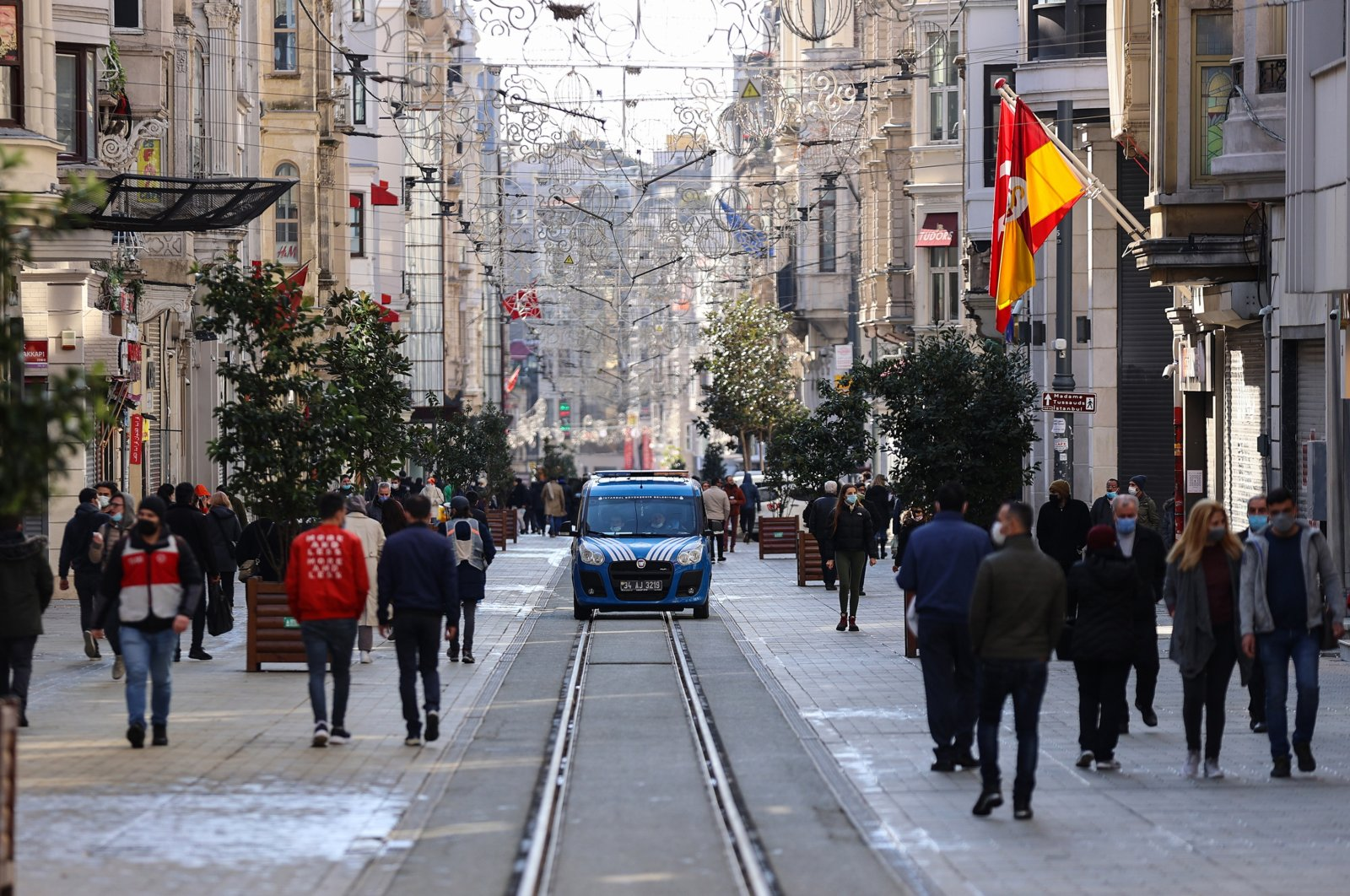 People wearing masks walk on the Istiklal Avenue in Istanbul's Beyoğlu on Feb. 21, 2021 (AA File Photo)