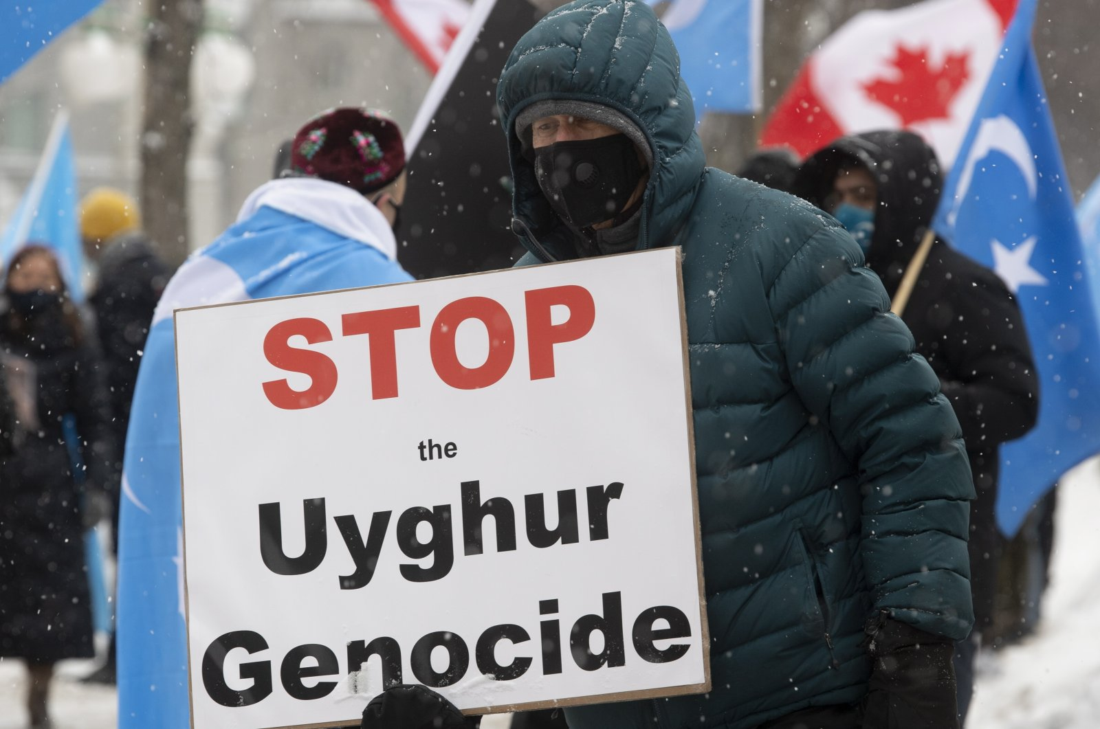 Protesters gather outside the Parliament buildings in Ottawa, Ontario Monday, Feb. 22, 2021. (AP)