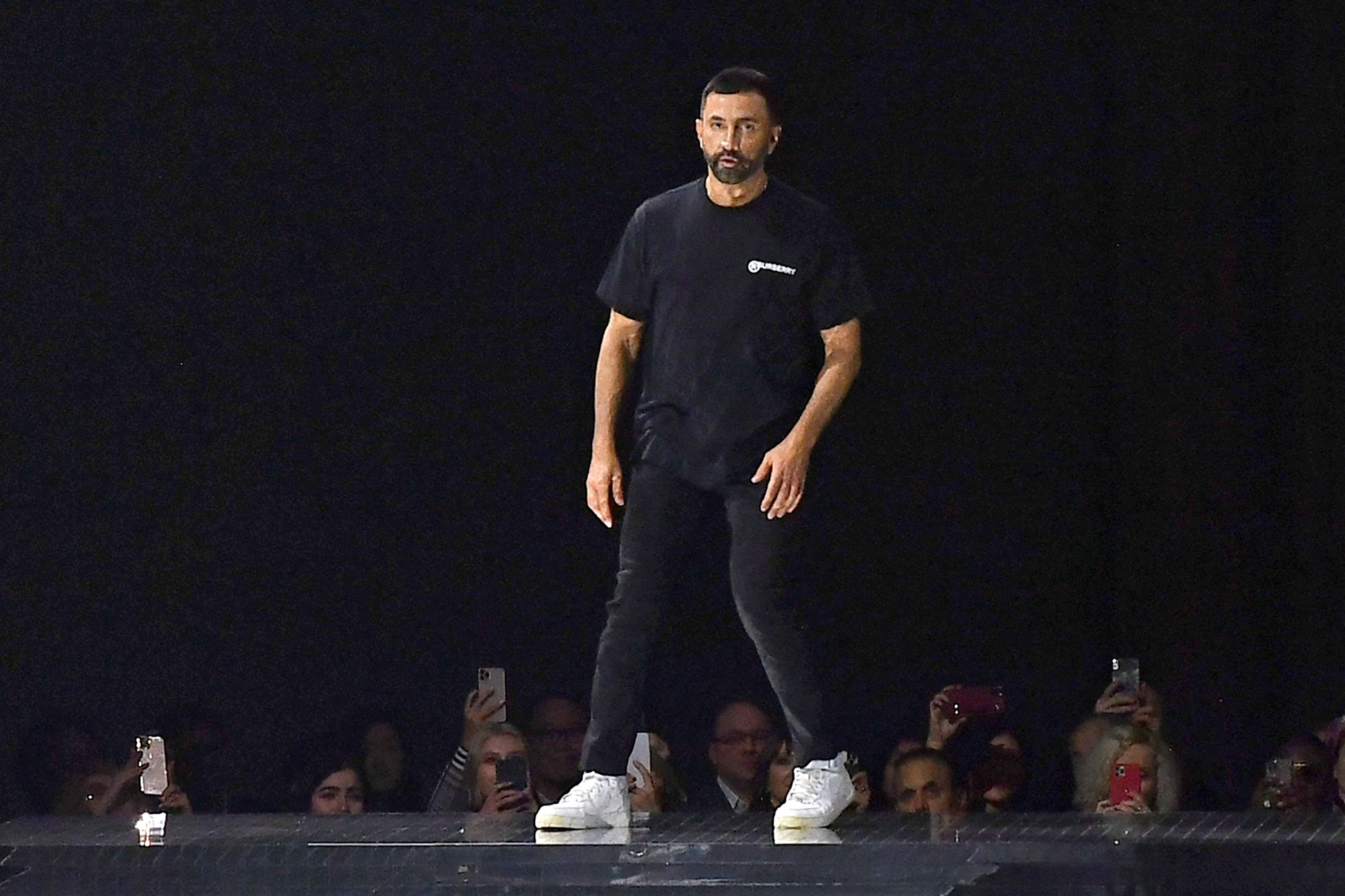 In this file photo taken on February 17, 2020 Chief Creative Officer for Burberry, Riccardo Tisci acknowledges the applause from the audience after the Burberry 2020 Autumn / Winter collection catwalk show during London Fashion Week in London. (AFP Photo)