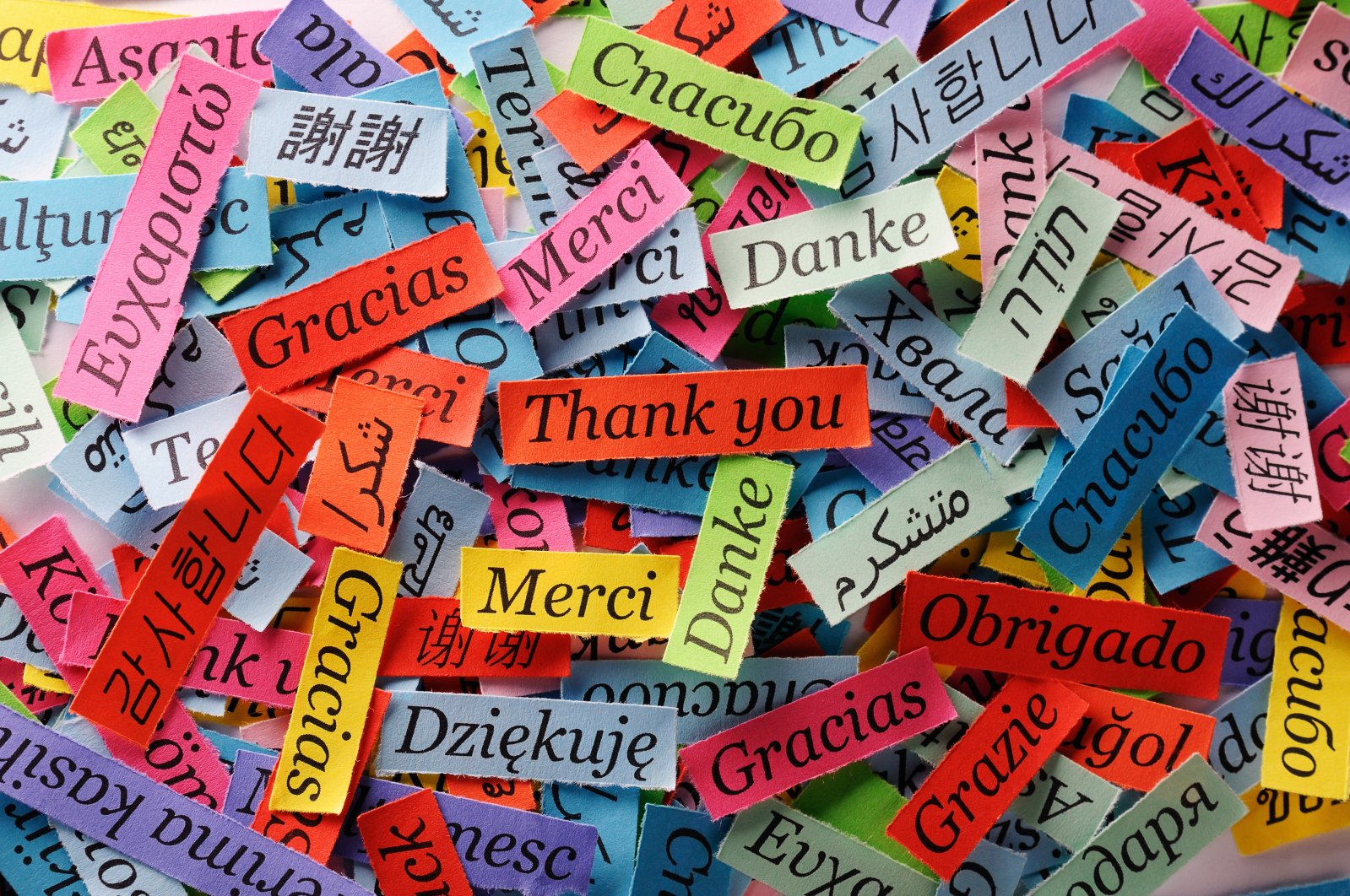"""The phrase """"Thank You"""" printed on colorful papers in different languages. (Shutterstock Photo)"""