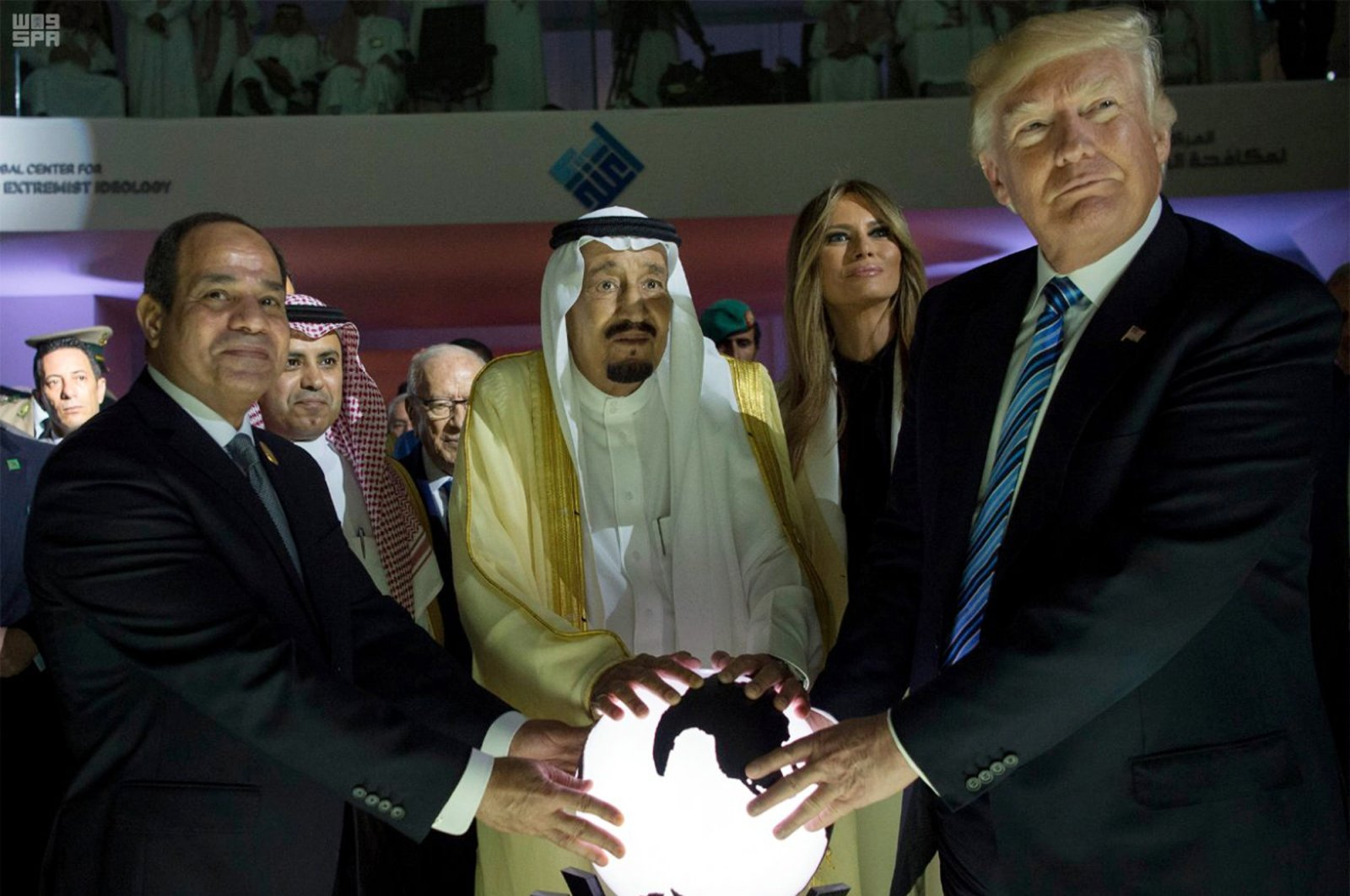 From left to right, Egyptian President Abdel-Fattah el-Sissi, Saudi King Salman, then U.S. First Lady Melania Trump and then U.S. President Donald Trump put their hands on an illuminated globe during the inauguration ceremony of the Global Center for Combating Extremist Ideology, Riyadh, Saudi Arabia, May 21, 2017. (AP Photo)