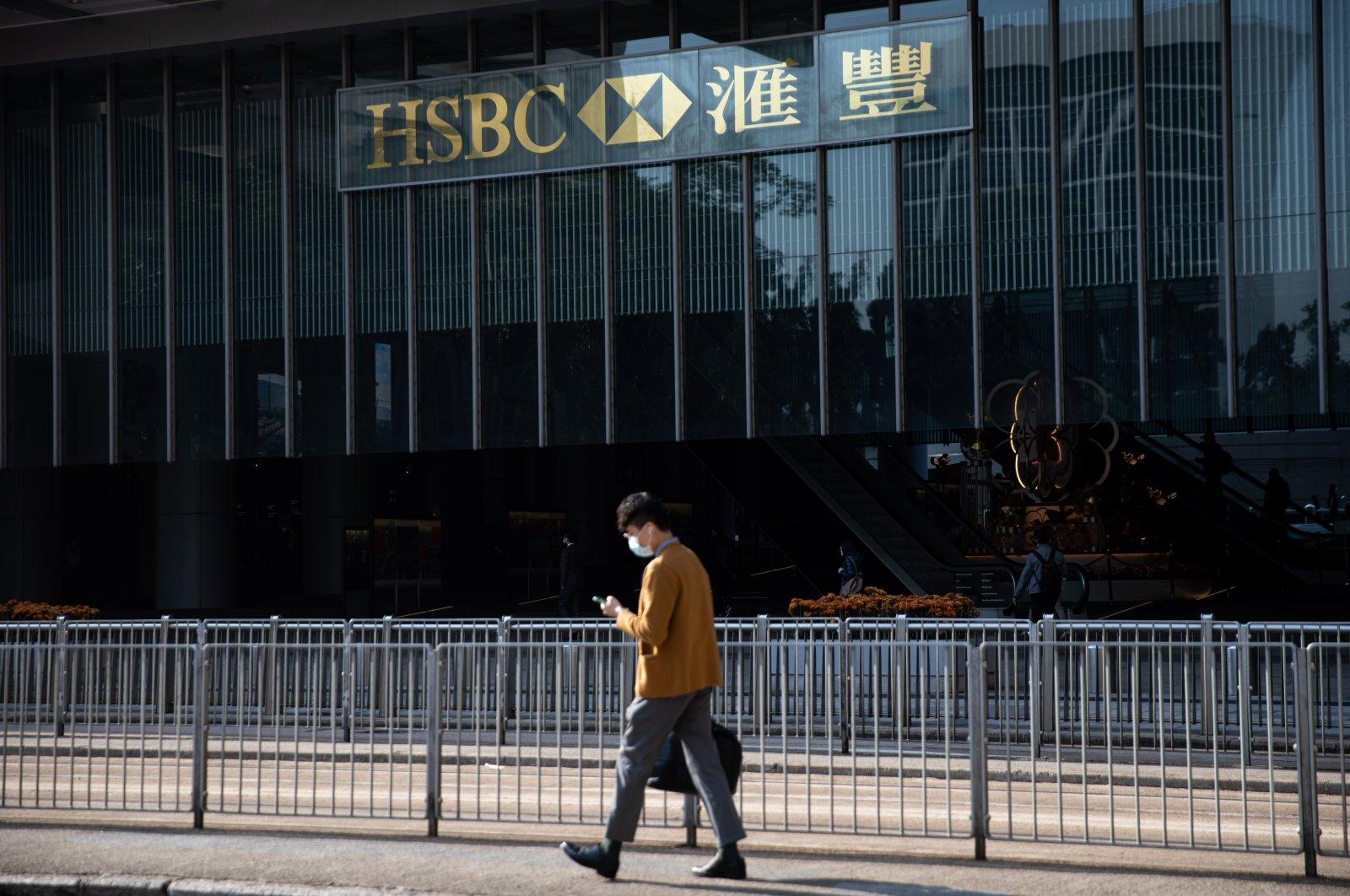 A man walks past the Hong Kong and Shanghai Banking Corporation, (HSBC), headquarters building in Hong Kong, China, Feb. 23, 2021. (EPA Photo)