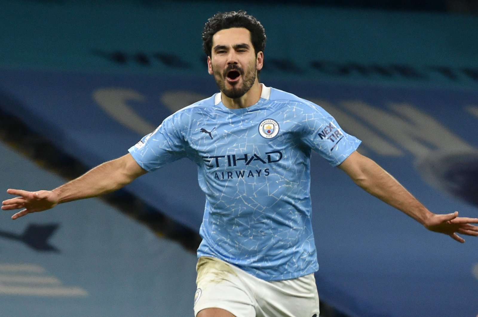 Manchester City's German-Turkish midfielder İlkay Gündoğan celebrates scoring his team's third goal during a Premier League match against Tottenham Hotspur at the Etihad Stadium in Manchester, England, Feb. 13, 2021. (AFP Photo)