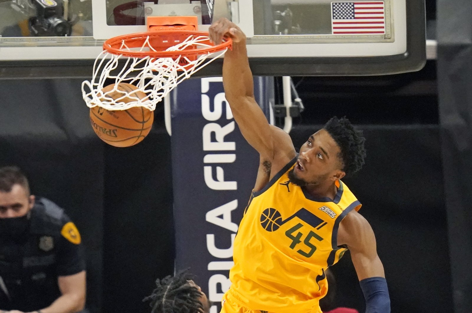 Utah Jazz guard Donovan Mitchell dunks against the Charlotte Hornets in an NBA basketball game in Salt Lake City, U.S., Feb. 22, 2021. (AP Photo)