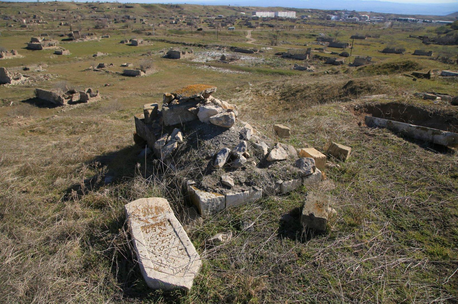The scene of damaged graveyards in Jabrayil cemetery in Nagorno-Karabakh, Azerbaijan, Feb.23, 2021. (AA)