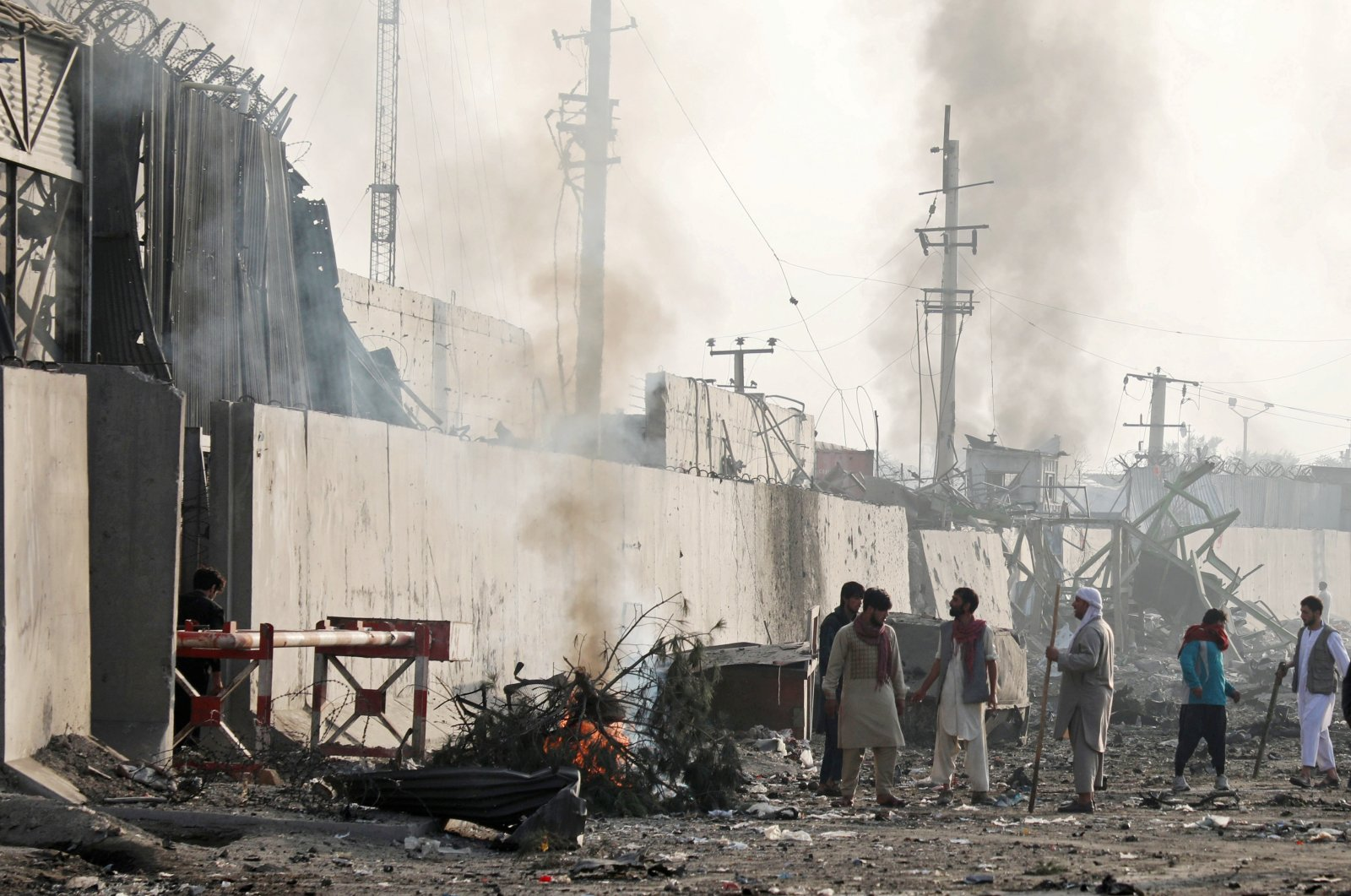 Angry Afghan protesters burn tyres and shout slogans at the site of a blast in Kabul, Afghanistan on Sept. 3, 2019. (Reuters Photo)