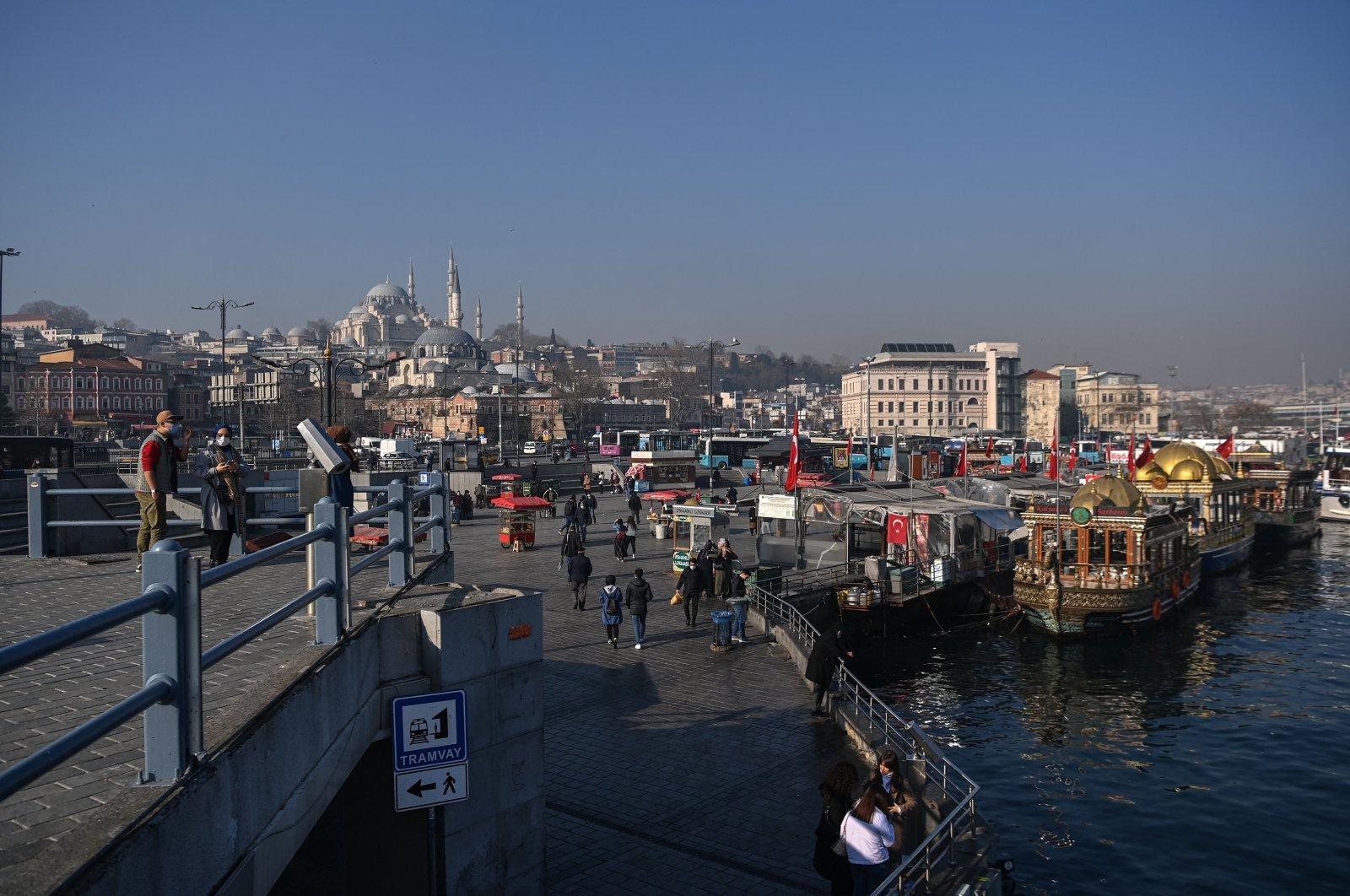 Fish vendors boats in the Eminönü neighborhood aginst Süleymaniye Mosque seen in the background, in Istanbul, Feb. 23, 2021. (AFP Photo)