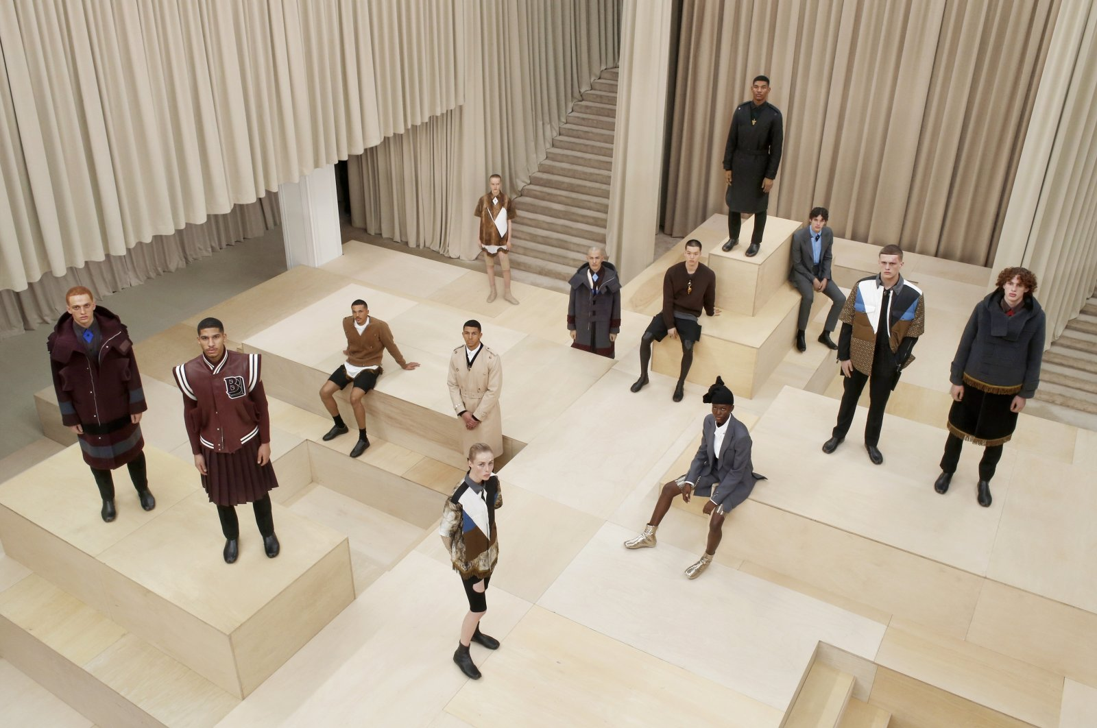 In this handout image provided by Burberry, models pose on the runway during the Burberry Autumn/Winter 2021 Menswear Presentation during LFW February 2021 at the Burberry flagship Regent Street store on February 22, 2021 in London, United Kingdom. (Burberry via Getty Images)