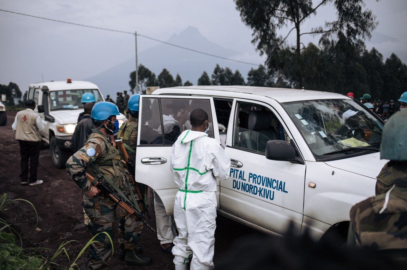 The body of a driver, who was killed in an attack, is loaded on to a medical vehicle on a road on the edge of the Virunga National Park near the village of Kibumba, some 25 kilometers from Goma, Democratic Republic of the Congo, Feb. 22, 2021.