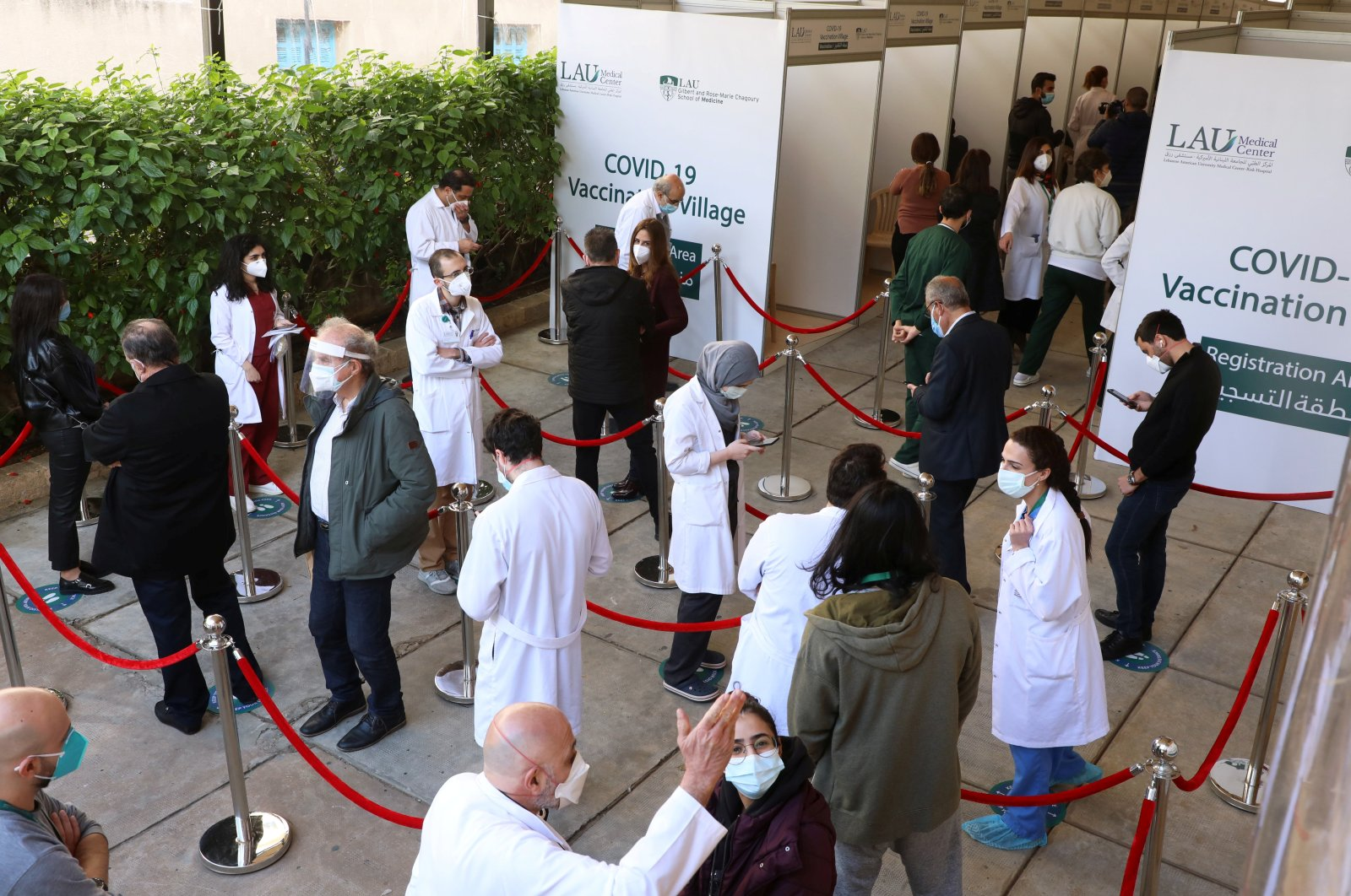 Health care workers wait to receive the Pfizer/BioNTech COVID-19 vaccine during a coronavirus vaccination campaign at Lebanese American University Medical Center-Rizk Hospital in Beirut, Lebanon, Feb. 16, 2021. (Reuters Photo)