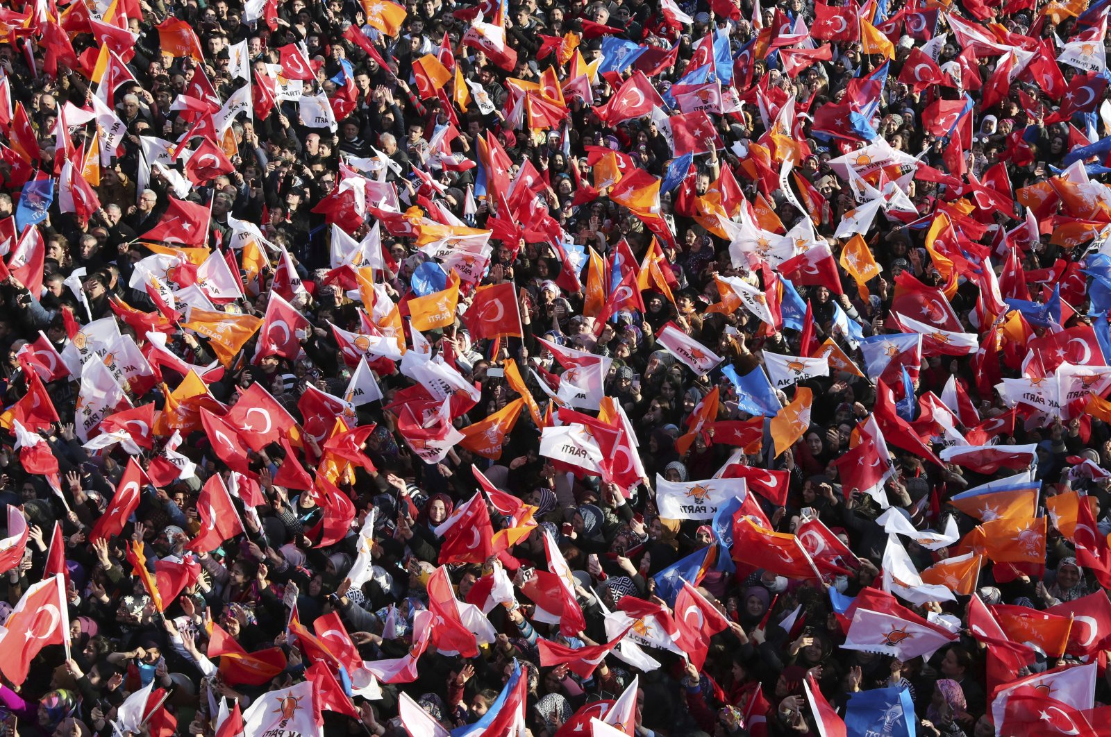 Supporters of Turkey's President Recep Tayyip Erdoğan's ruling Justice and Development Party (AK Party) wave Turkish and party flags during his speech at a rally in Bartın, Turkey, March 4, 2019. (Presidential Press Service via AP, Pool)