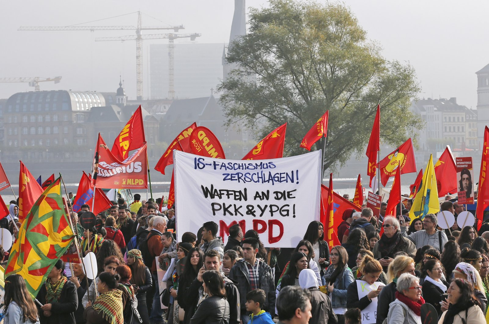 """Terrorist YPG/PKK demonstrate in Duesseldorf, Germany, Saturday, Oct. 11, 2014. Banner reads: """"Annihilate Daesh-fascism! Weapons for the PKK & YPG!"""" (AP File Photo)"""