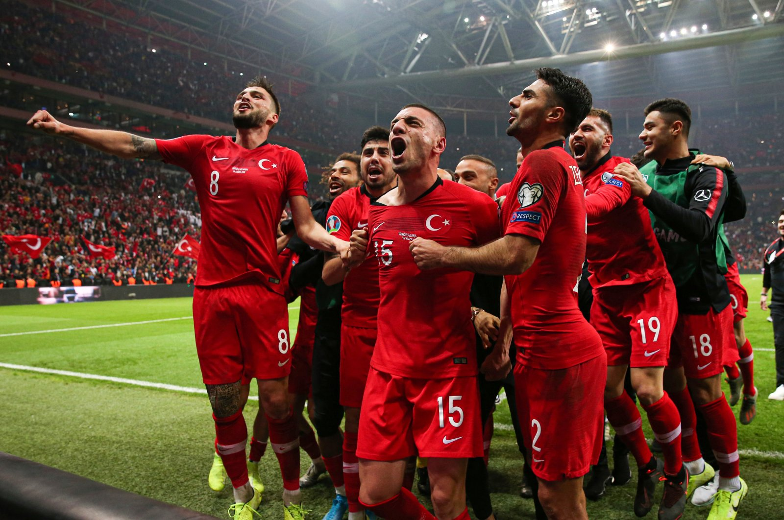 The Turkish national football team celebrates qualifying for the Euro 2020 after holding Iceland to a 0-0 draw at the Türk Telekom Stadium, Istanbul, Turkey, Nov. 14, 2021. (AA Photo)