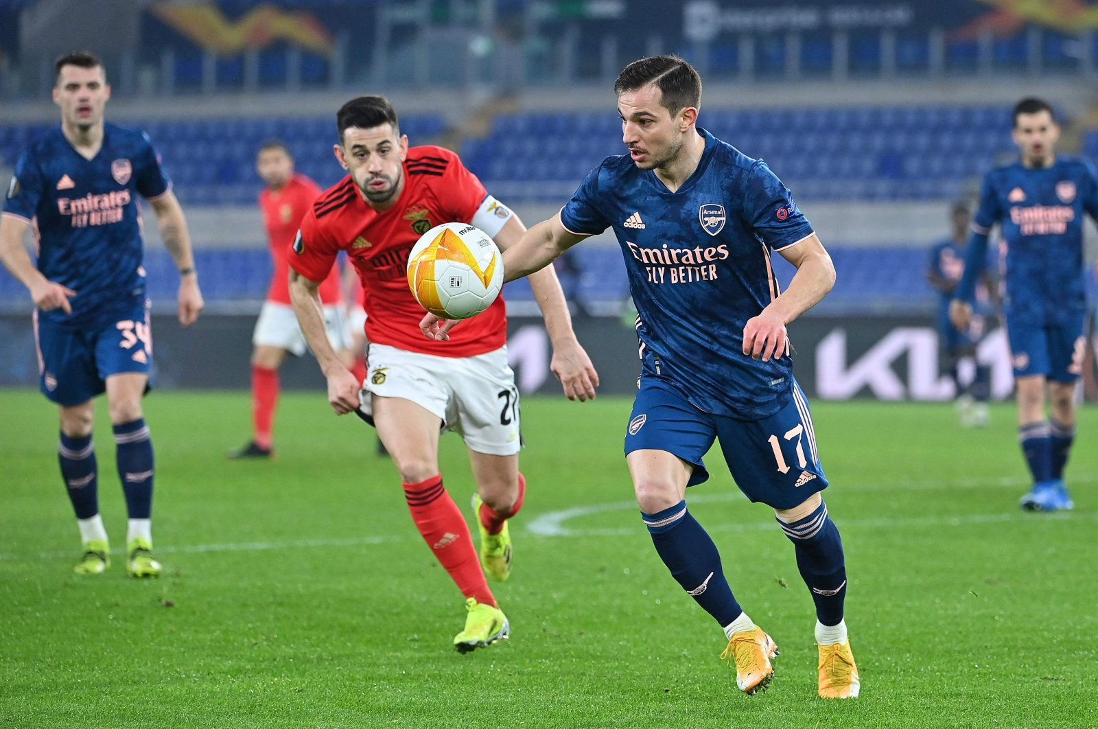 Arsenal defender Cedric Soares (R) challenges Benfica midfielder Pizzi during the UEFA Europa League round of 32 first leg match at the Olimpico stadium, Rome, Italy, Feb. 18, 2021. (AFP Photo)
