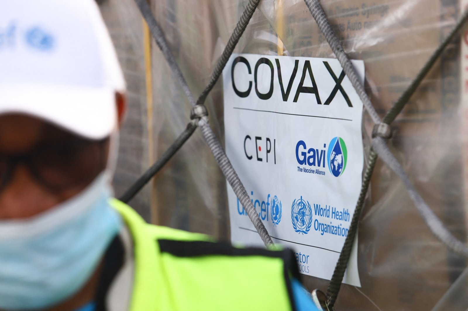 This photograph shows a Covax tag on a shipment of COVID-19 vaccines from the Covax global COVID-19 vaccination program, at the Kotoka International Airport in Accra, Feb. 24, 2021. (AFP Photo)