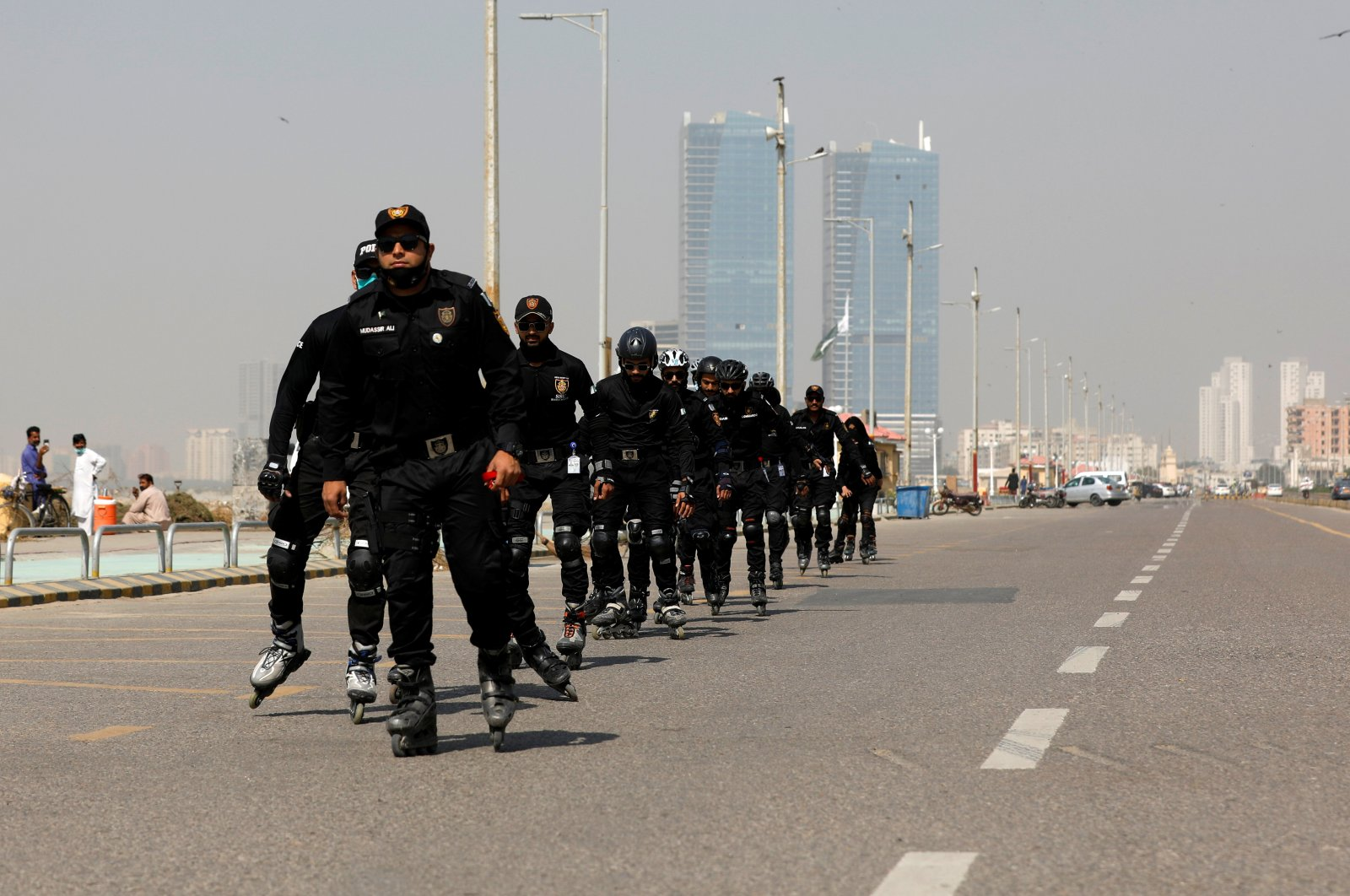 Special Security Unit (SSU) police members rollerblade during practice along the seafront in Karachi, Pakistan, Feb. 19, 2021. (Reuters Photo)
