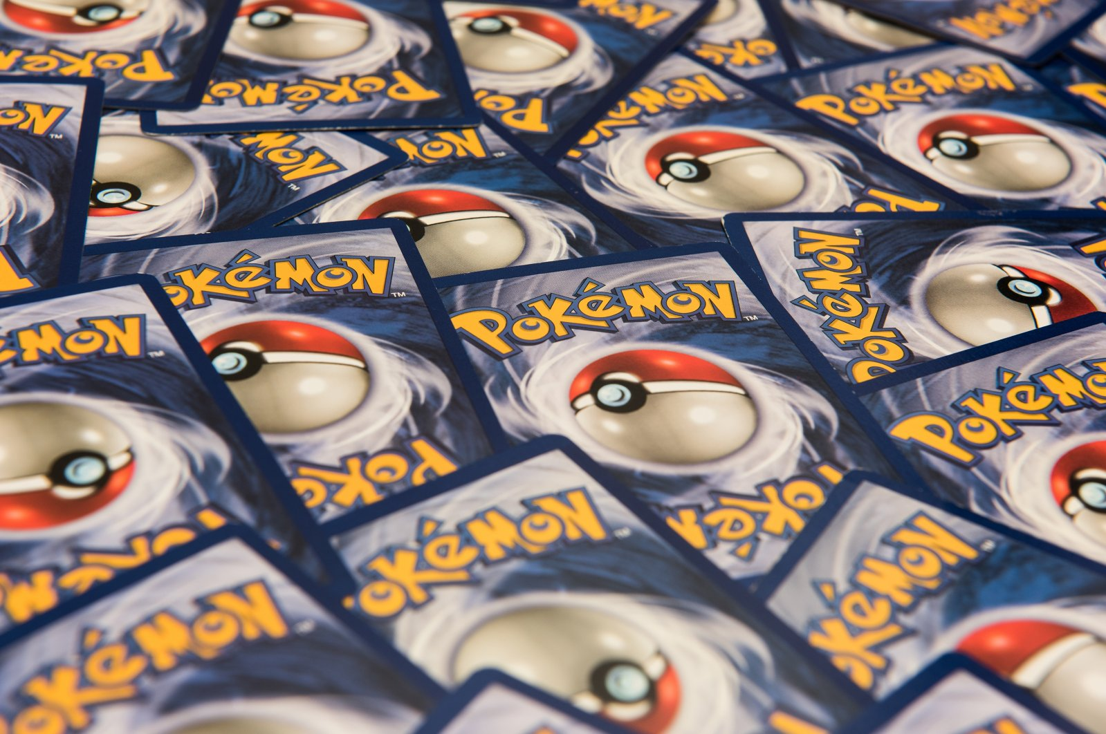 The back side of Pokemon trading cards can be seen, New York City, USA, July 12, 2016. (Shutterstock Photo)