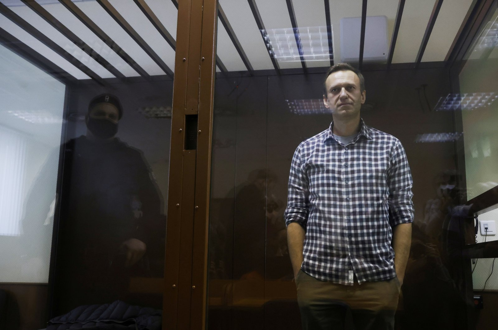 Russian opposition politician Alexei Navalny attends a hearing to consider an appeal against an earlier court decision to change his suspended sentence to a real prison term, in Moscow, Russia, Feb. 20, 2021. (Reuters Photo)