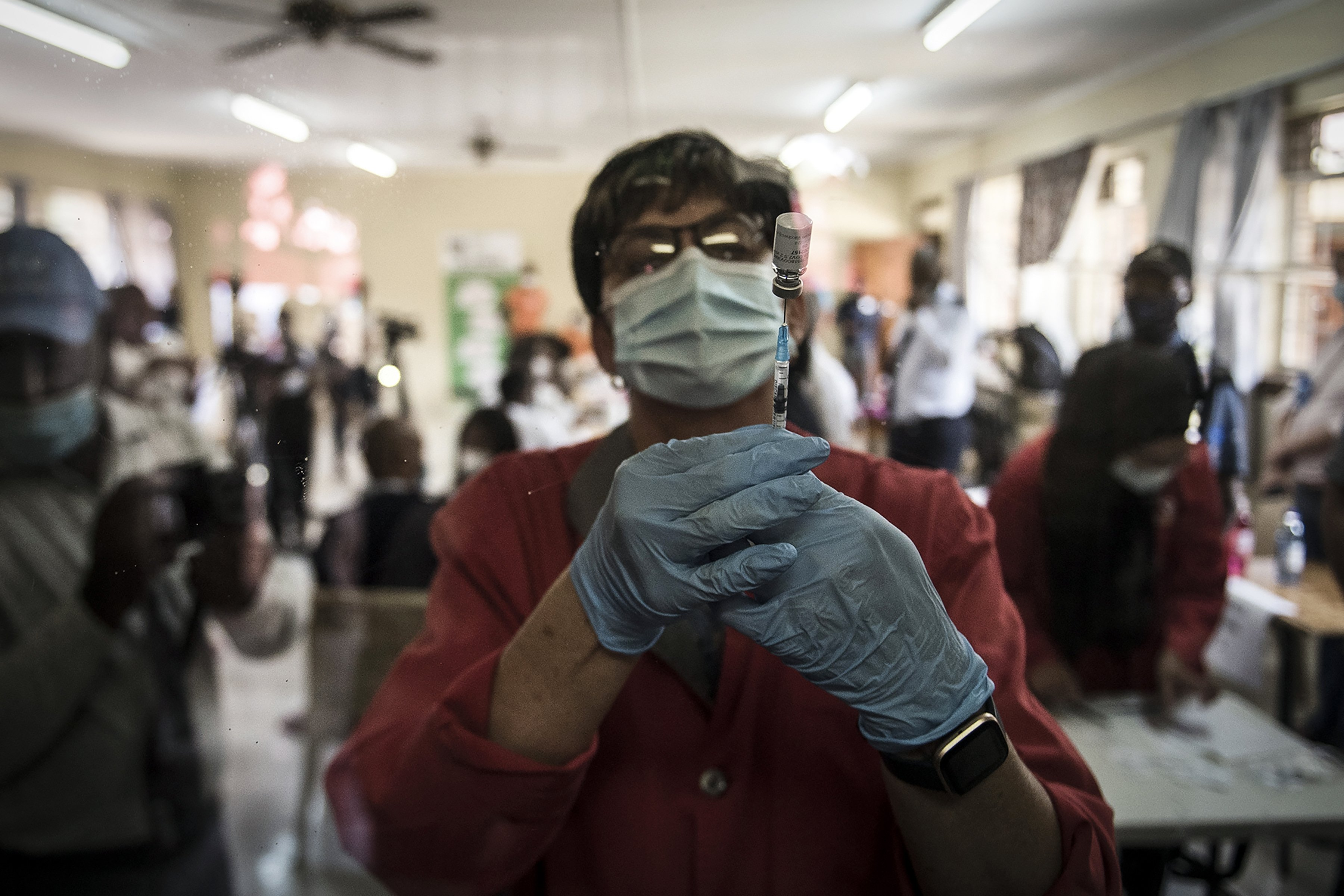 A pharmacist prepares the Johnson & Johnson COVID-19 vaccine to administer to health care workers at the government hospital in Klerksdorp, South Africa, Feb. 18, 2021. (AP Photo/Shiraaz Mohamed)