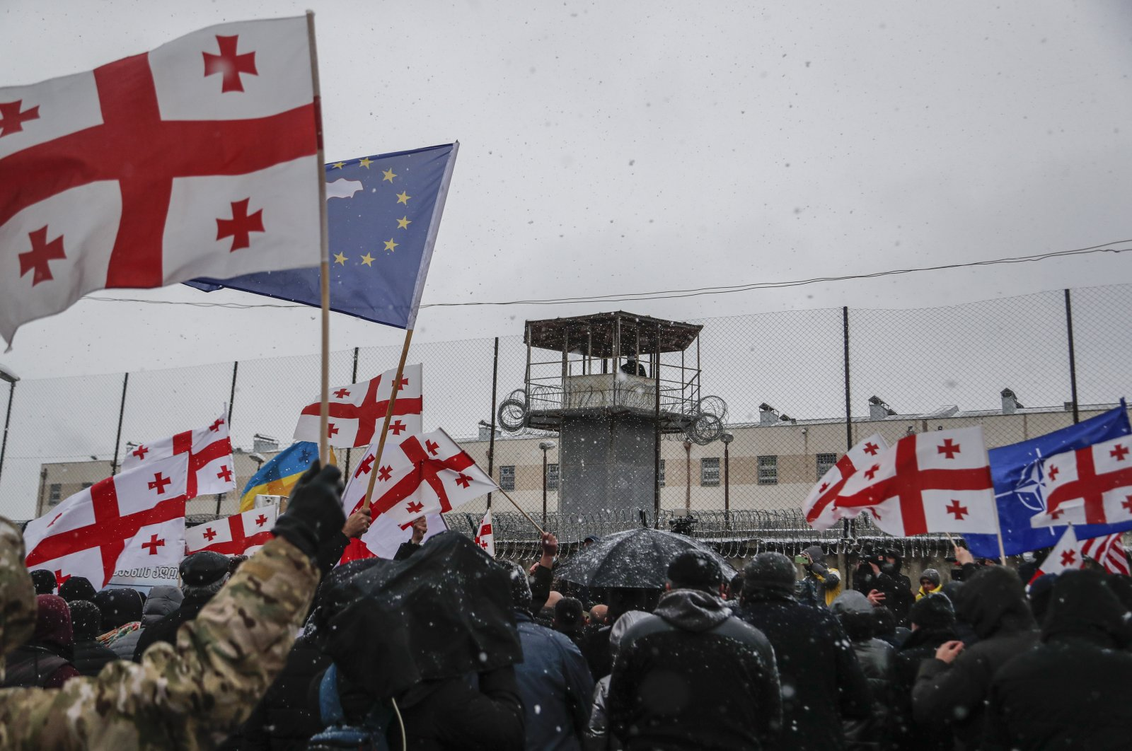 People protest during a rally in support of Georgian opposition leader Nika Melia in front of a prison in Rustavi, about 20 kilometers (12.4 miles) from Tbilisi, Georgia, Feb. 24, 2021. (EPA Photo)