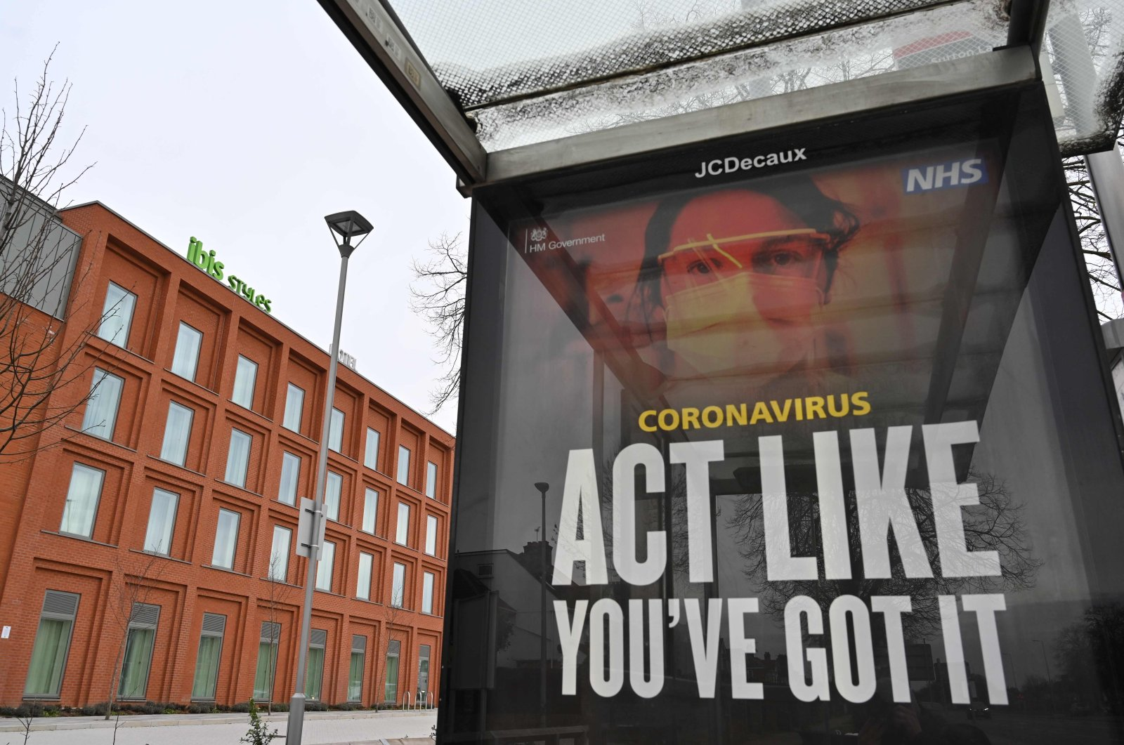 An NHS advertisement in front of an Ibis Styles hotel near London Heathrow Airport in west London, England, Feb. 14, 2021. (AFP Photo)