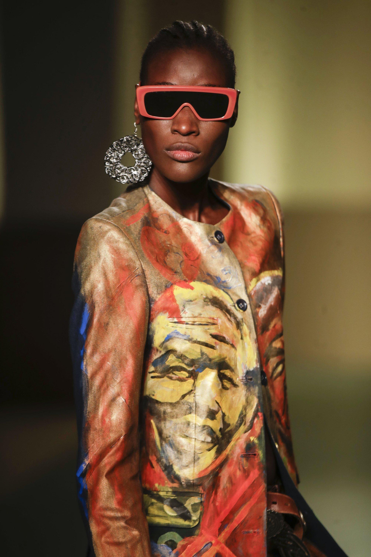 A model wears creations by fashion designer Fabiola Manirakiza Frida Kiza, as part of the collective Black Lives Matter Fall / Winter 2021/22 fashion show, presented in Milan, Italy, 17 February 2021. (AP Photo)