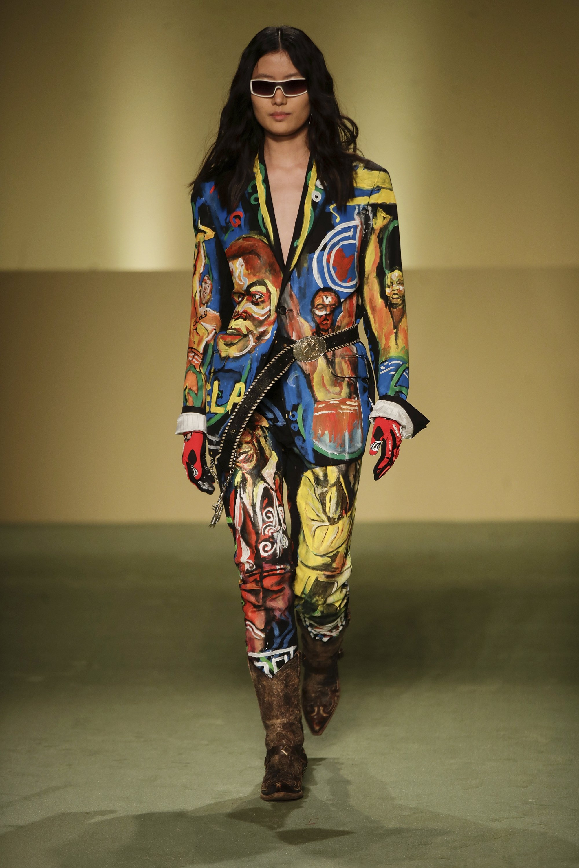 A model wears creations by fashion designer Mokodu Fall as part of the collective Black Lives Matter Fall / Winter 2021/22 fashion show, presented in Milan, Italy, February 17, 2021. (AP Photo)