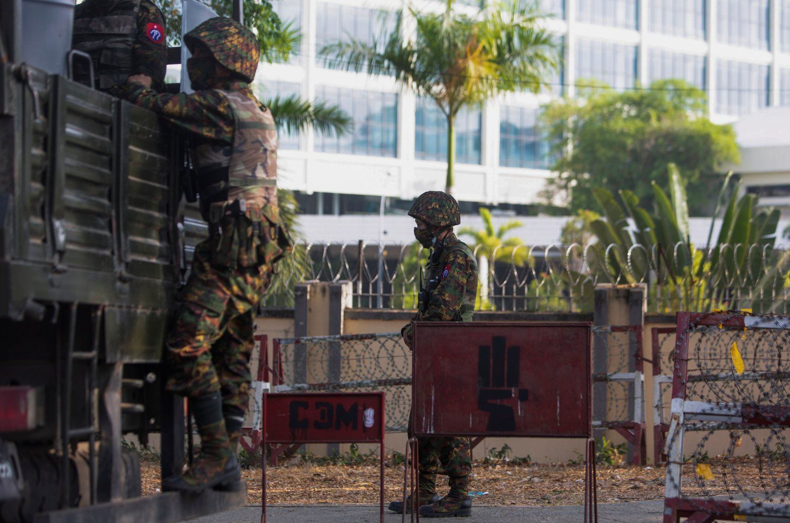 A soldier stands guard next to an army vehicle outside Myanmar's central bank, in Yangon, Myanmar, Feb 15, 2021. (Reuters Photo)