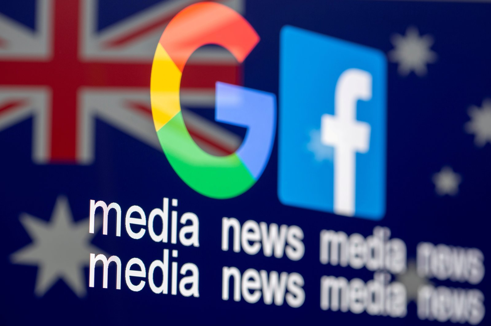 """The Google and Facebook logos, the words """"media, news, media"""" and the Australian flag are displayed in this illustration photo taken Feb. 18, 2021. (Reuters Photo)"""