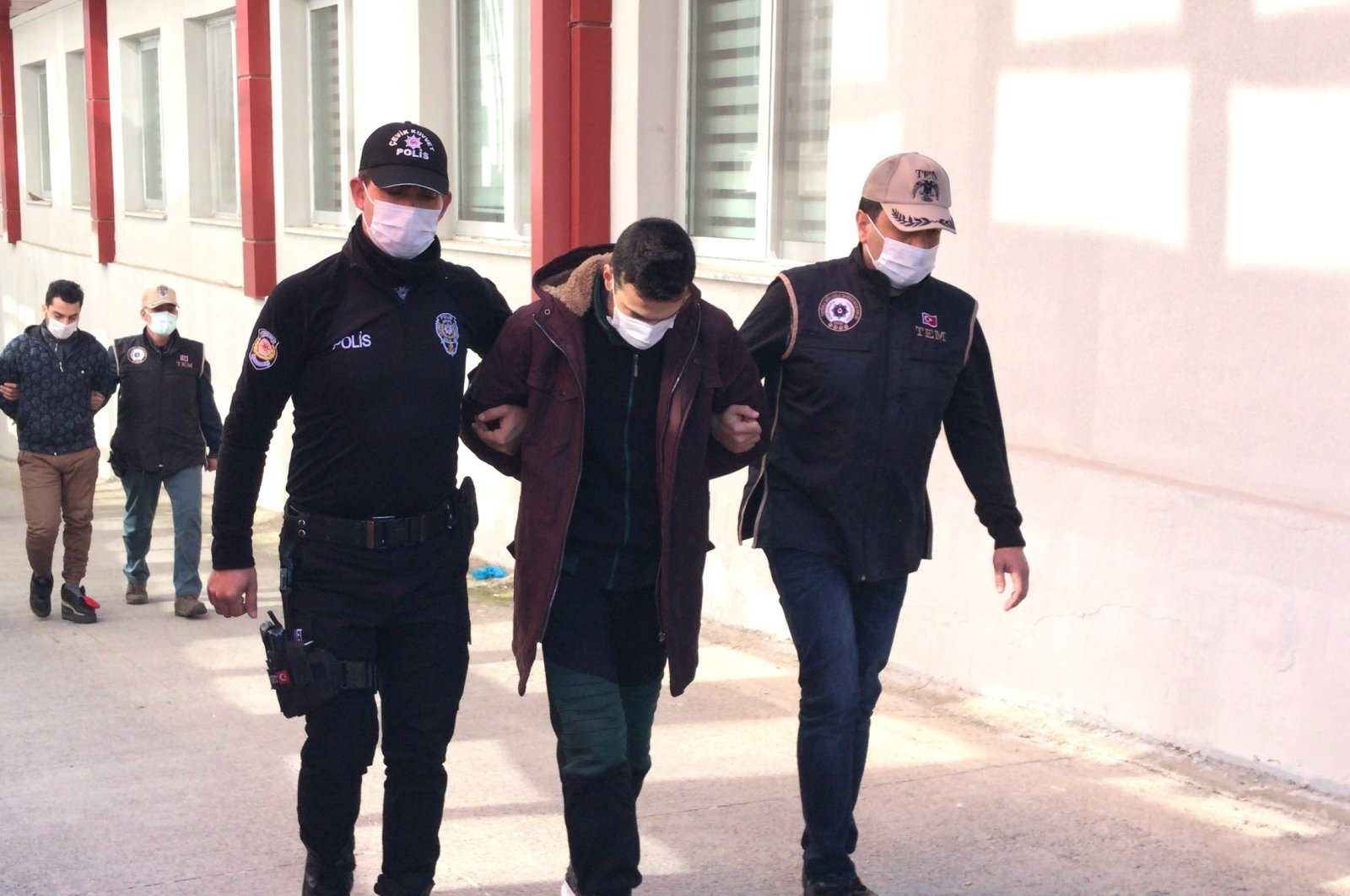 Police escort a Daesh terrorist to the courtroom in Turkey's southern Adana province on Feb. 25, 2021 (AA Photo)