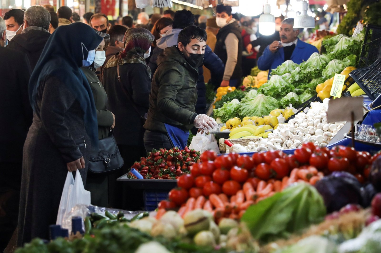 People wearing protective masks shop at a local market amid the COVID-19 outbreak in Ankara, Turkey Feb. 24, 2021. (Reuters Photo)
