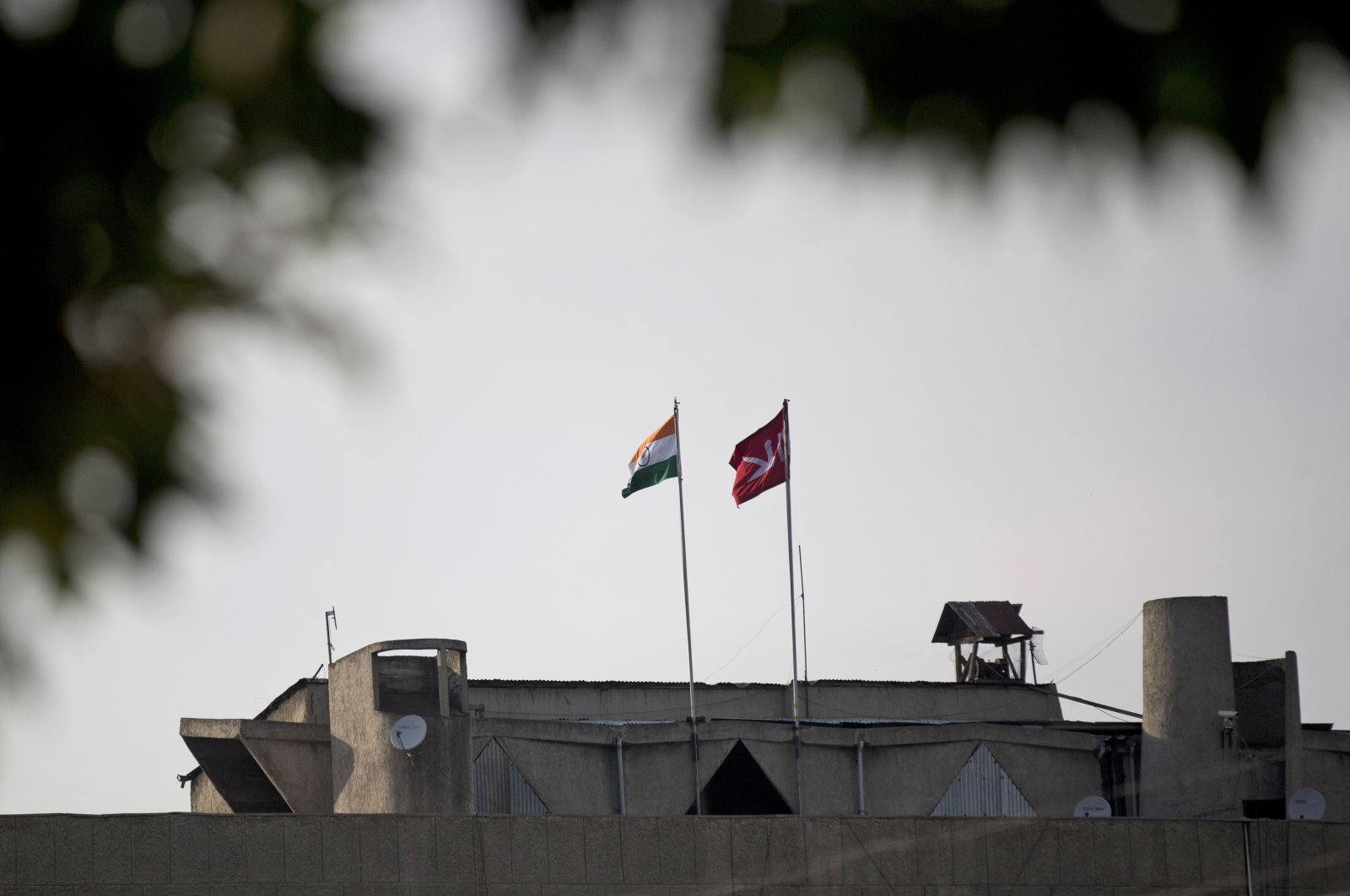 An Indian national flag (L) is hoisted next to a Jammu and Kashmir state flag on the government secretariat building after New Delhi scrapped the disputed region's semi-autonomy in Srinagar, Indian controlled Kashmir, Aug. 9, 2019. (AP Photo)