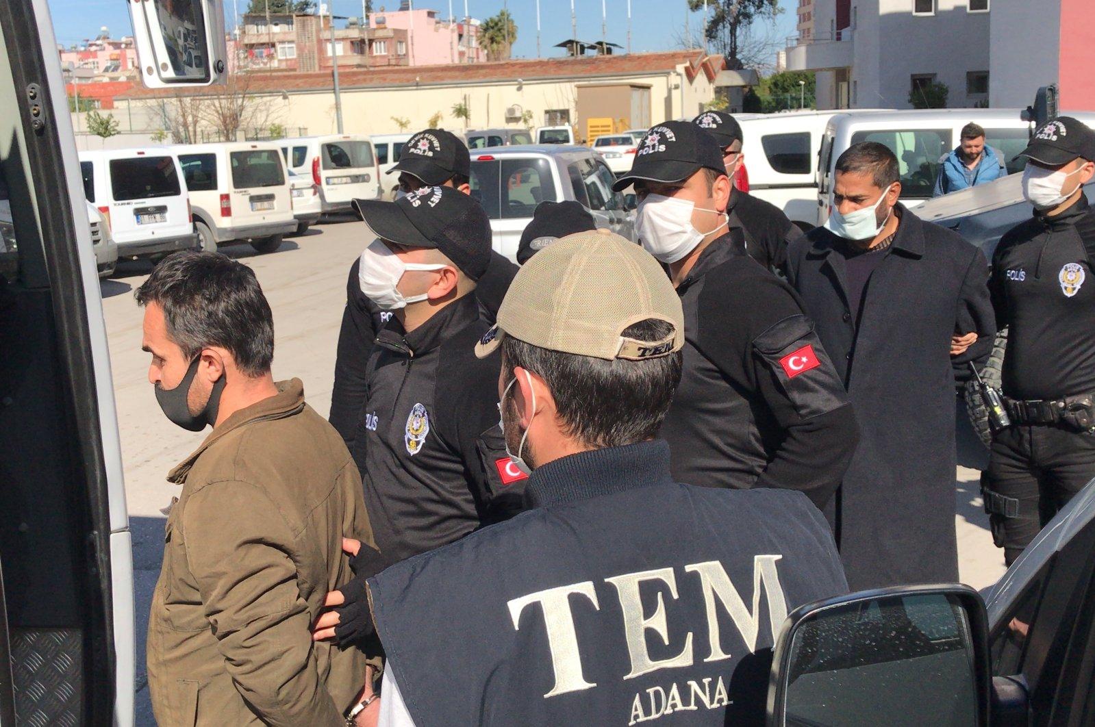 Police escort captured Daesh terrorists in Adana province, southern Turkey, Feb. 25, 2021. (AA Photo)