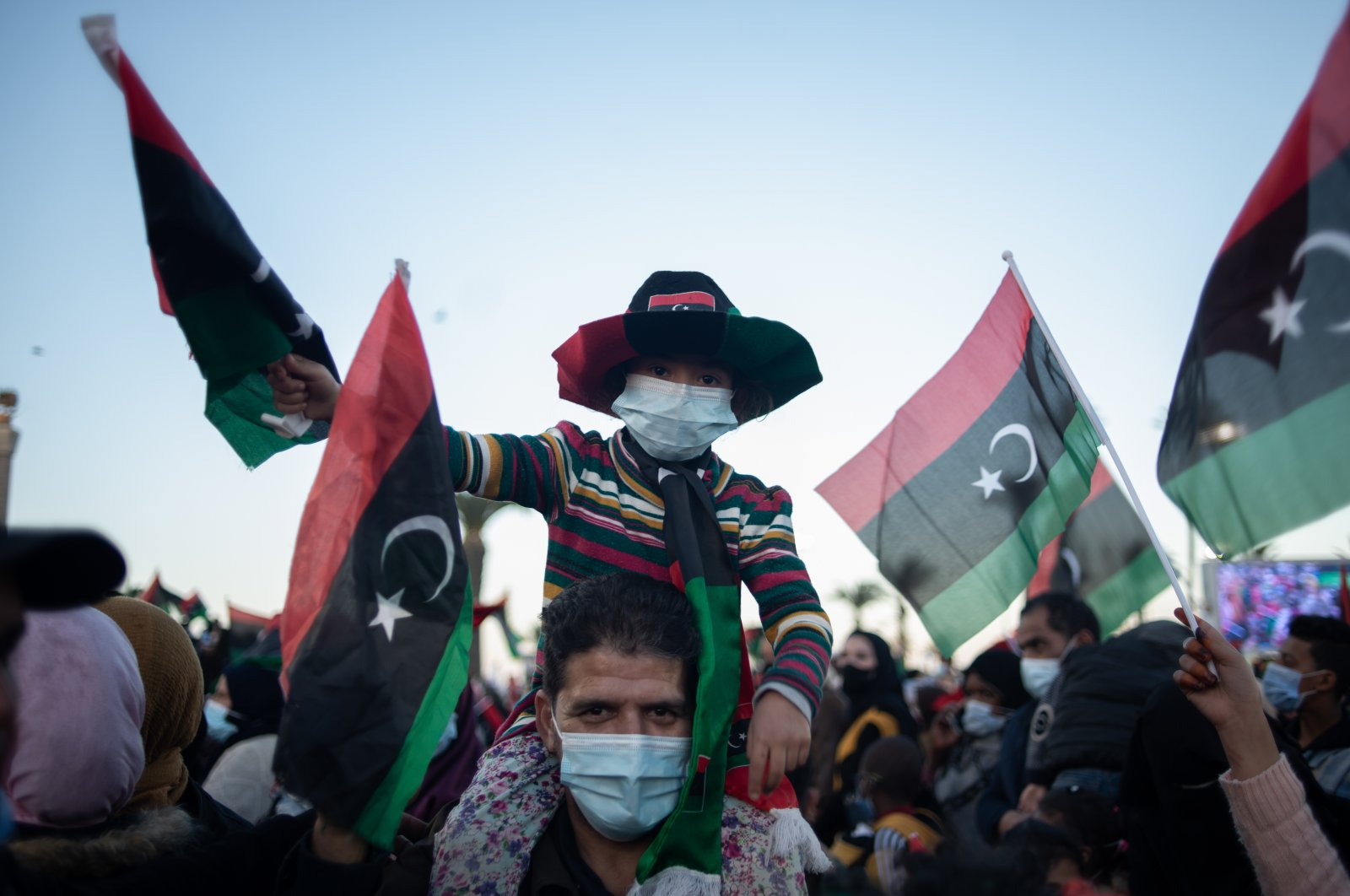 People wave flags and chant slogans to commemorate the 10th anniversary of the Arab Spring in Martyrs' Square, Tripoli, Libya, Feb. 17, 2021. (Photo by Getty Images)