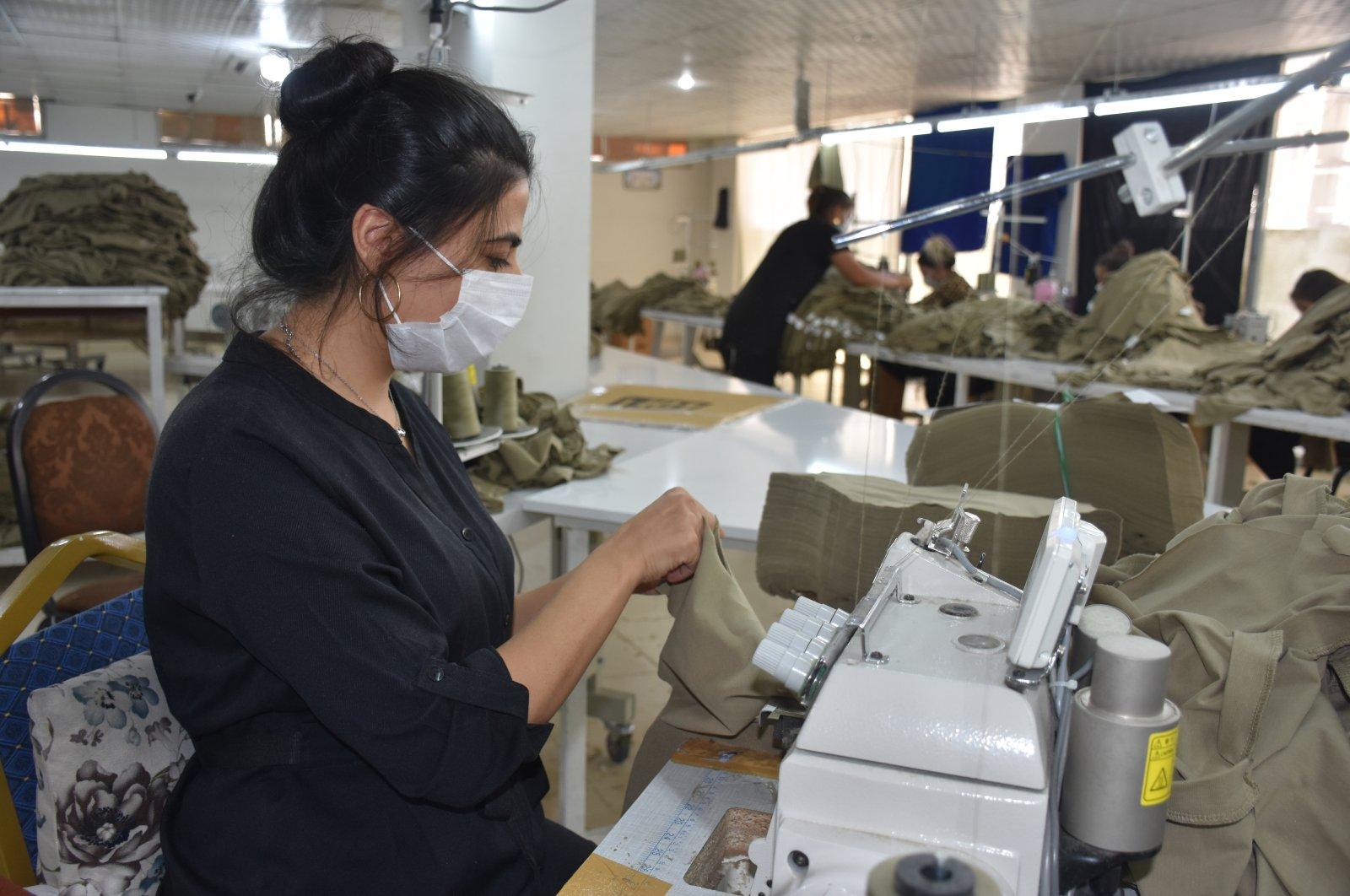 An employee seen in a textile factory in Şırnak province, southeastern Turkey, Feb. 25, 2021. (AA Photo)
