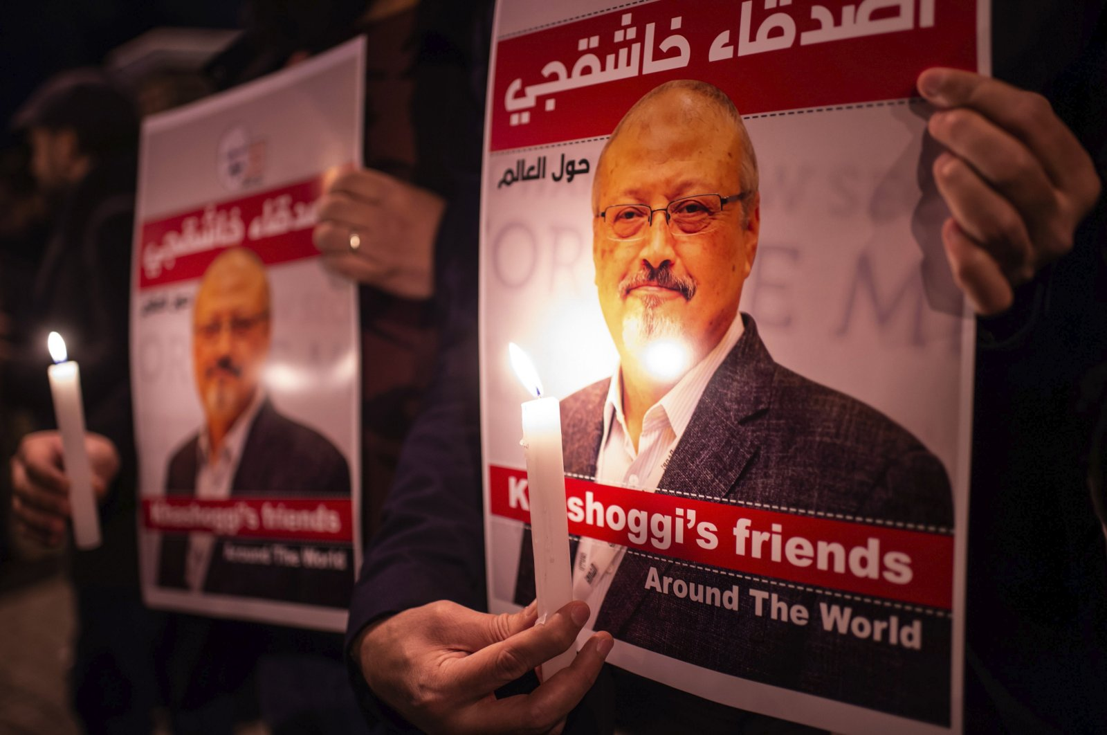 People hold posters featuring Saudi journalist Jamal Khashoggi during a gathering outside Saudi Arabia's consulate in Istanbul, Turkey, Oct. 25, 2018. (AFP Photo)