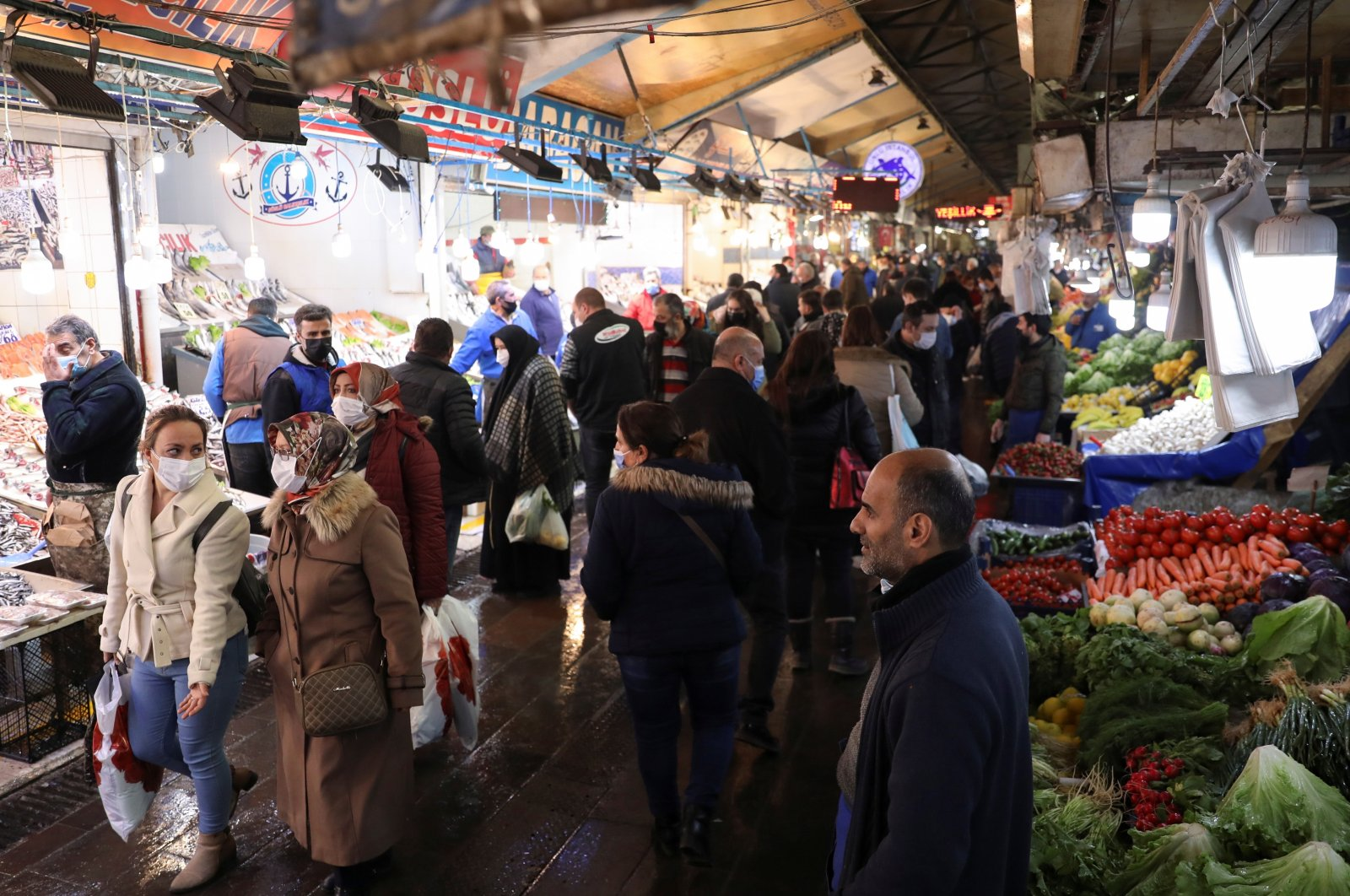 People wearing protective masks shop at a local market, amid the coronavirus outbreak, in the capital Ankara, Turkey, Feb. 24, 2021. (Reuters Photo)