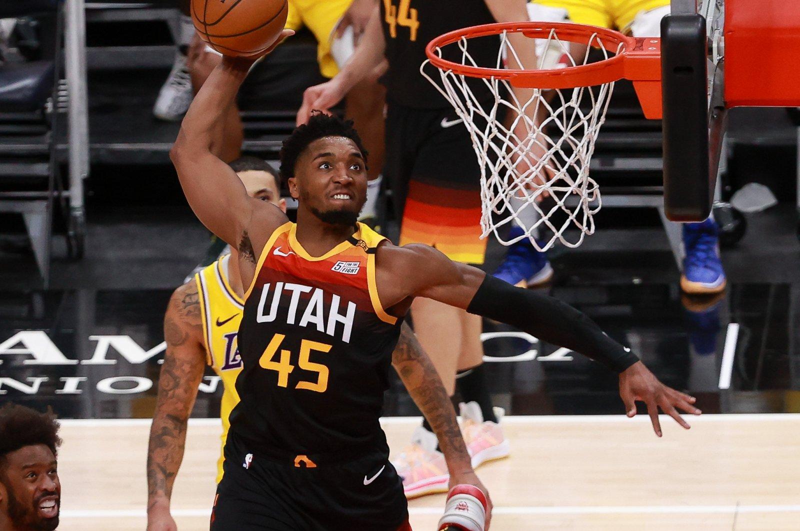 Utah Jazz guard Donovan Mitchell (45) dunks during an NBA match against the Los Angeles Lakers at Vivint Smart Home Arena, Salt Lake City, Utah, Feb 24, 2021. (Reuters Photo)