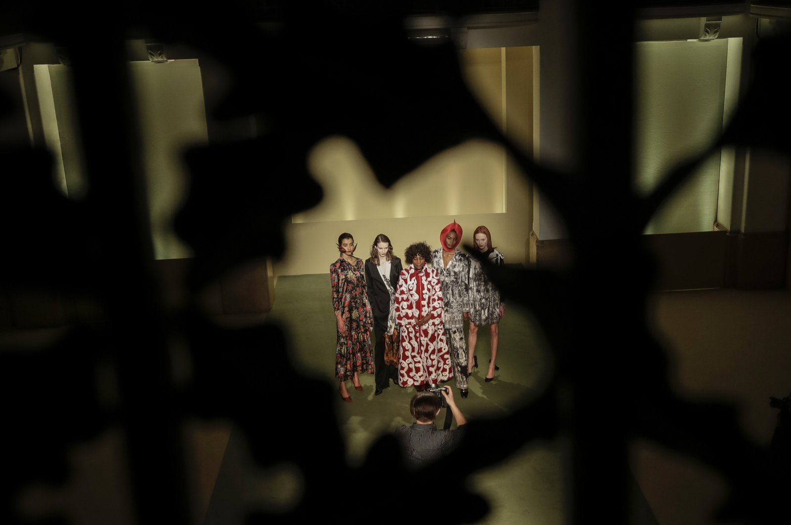 Fashion designer Fabiola Manirakiza, center, poses with models at the end of the Black Lives Matter Fall/Winter 2021/22 collective fashion show, presented in Milan, Italy, Feb. 17, 2021. (AP Photo)