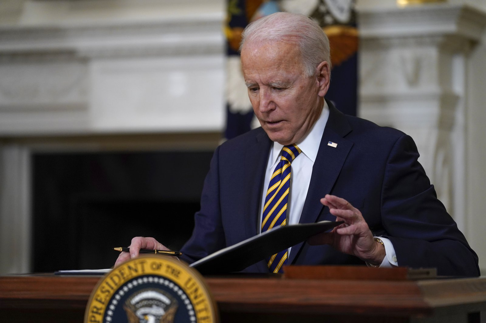 President Joe Biden closes a folder after signing an executive order relating to U.S. supply chains, in the State Dining Room of the White House, Washington, D.C., the U.S, Feb. 24, 2021. (AP Photo)
