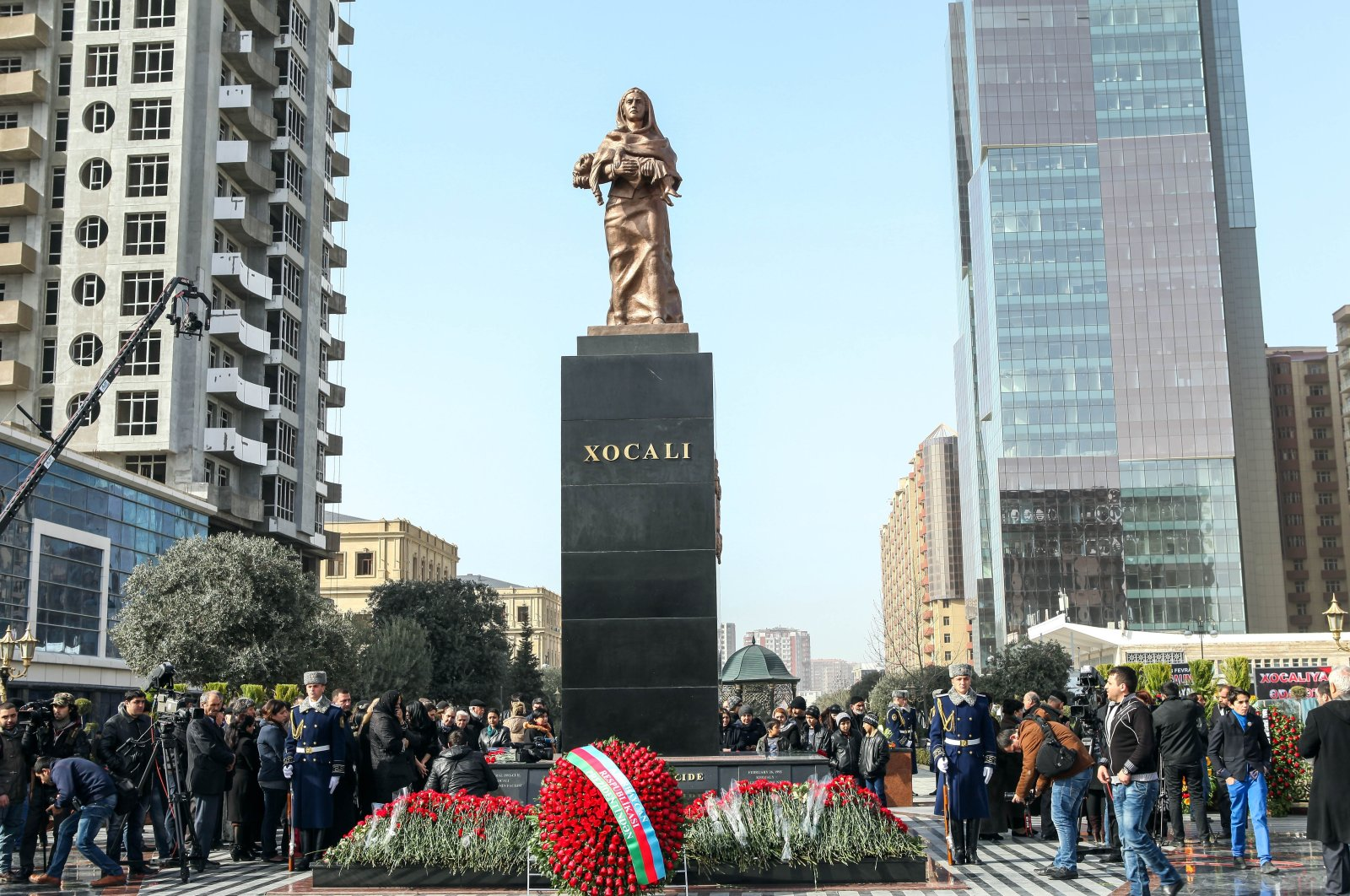 Azerbaijani citizens commemorate the Khojaly Massacre's anniversary by bringing flowers to the Cry of the Mother Monument erected in honor of the massacre victims in the capital Baku, Azerbaijan, Feb. 26, 2017. (Photo by Shutterstock)