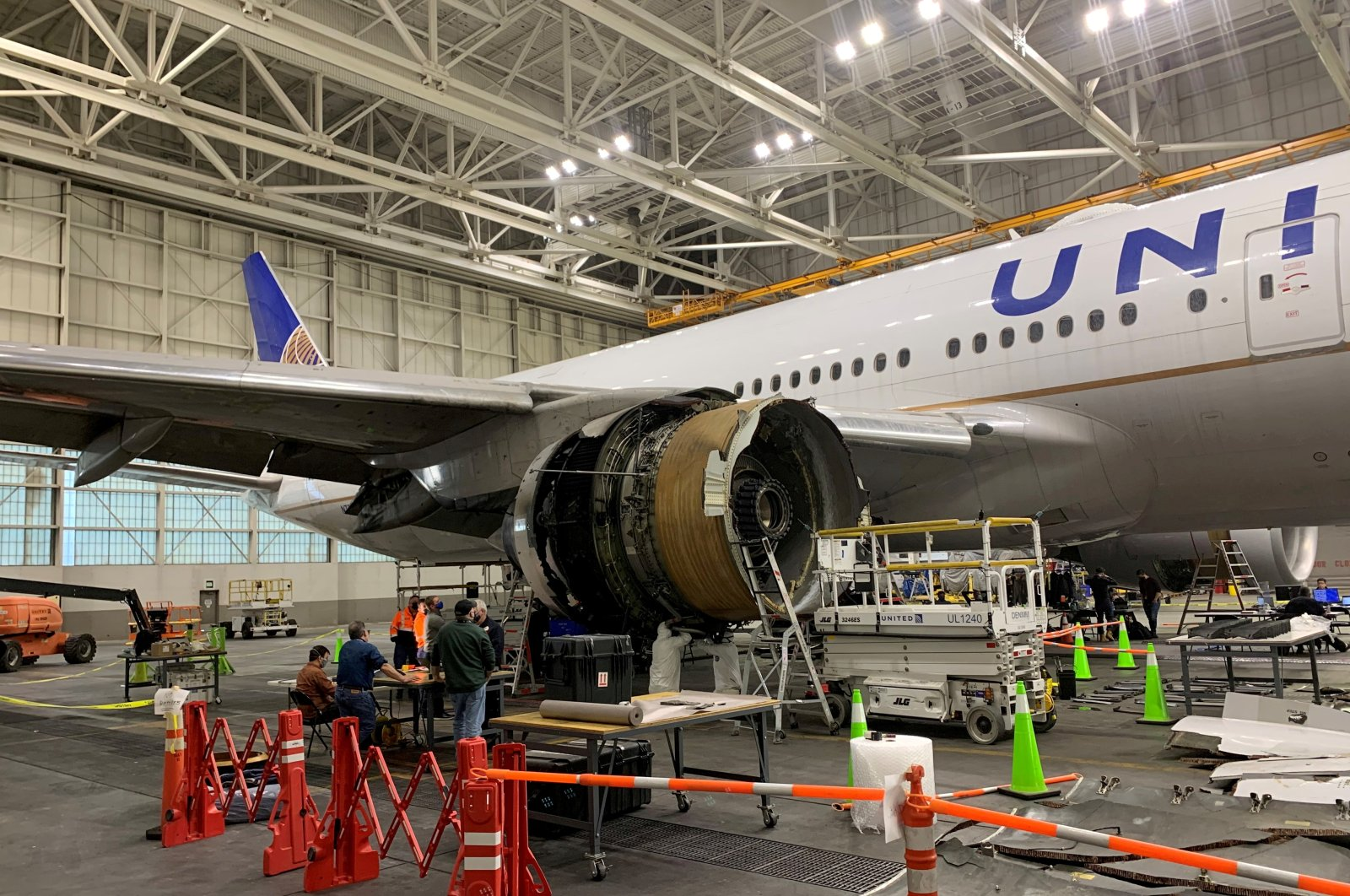 The damaged starboard engine of United Airlines flight 328, a Boeing 777-200, is seen following a Feb. 20 engine failure incident, in a hangar at Denver International Airport in Denver, Colorado, the U.S., Feb. 22, 2021. (Reuters Photo)