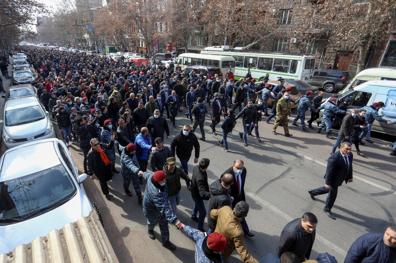 Armenian Prime Minister Nikol Pashinyan and his supporters march during a rally in Yerevan, Armenia Feb. 25, 2021. (Reuters)