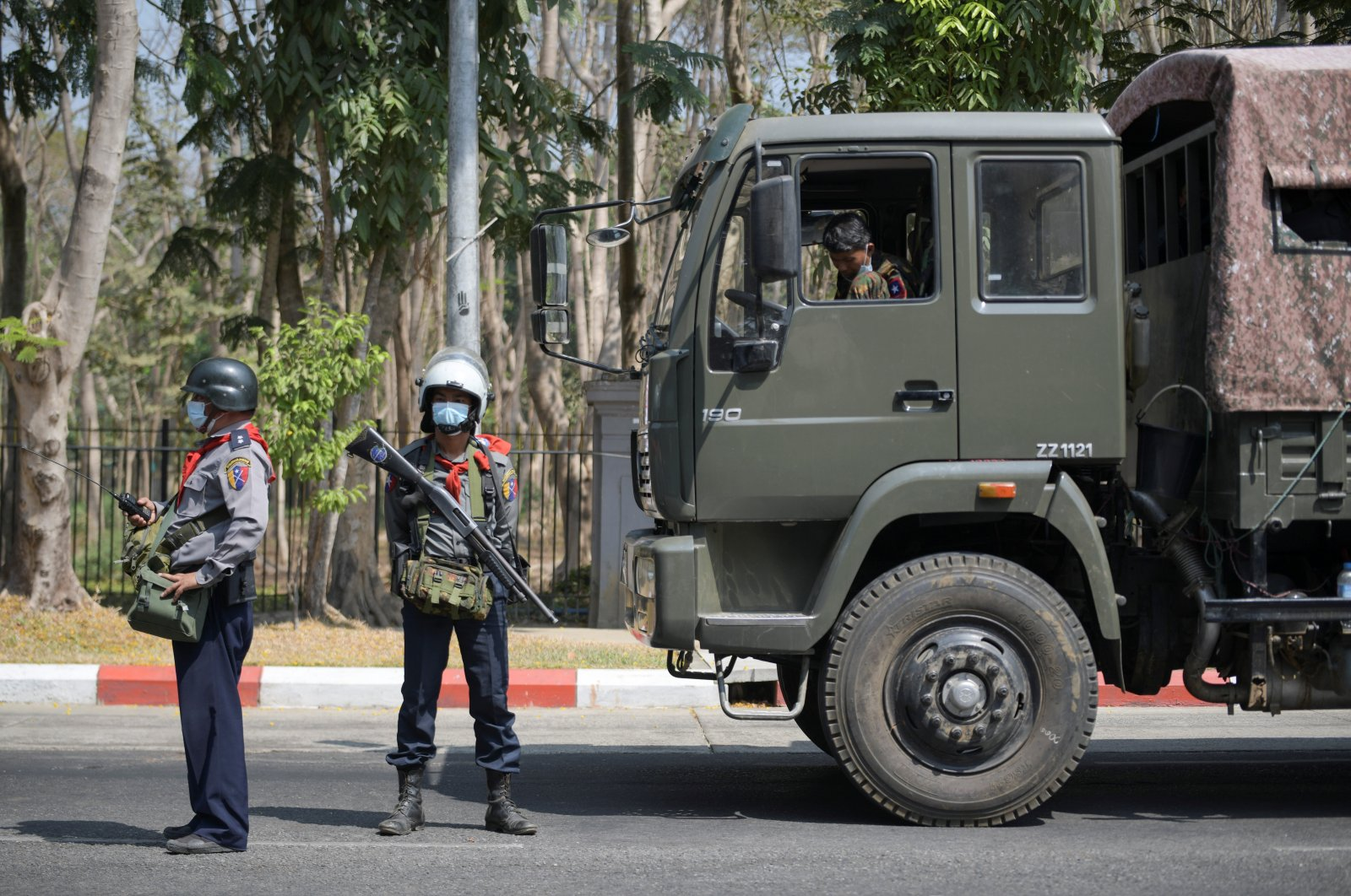 Riot police stand guard during a rally against the military coup at the University of Yangon, in Yangon, Myanmar, Feb. 25, 2021. (Reuters Photo)