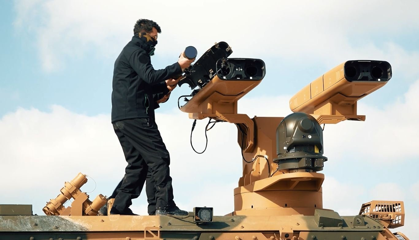 Company staff place missiles into the Sungur air defense system's launcher pods for test firing in this photo provided on Feb. 26, 2021. (DHA Photo)