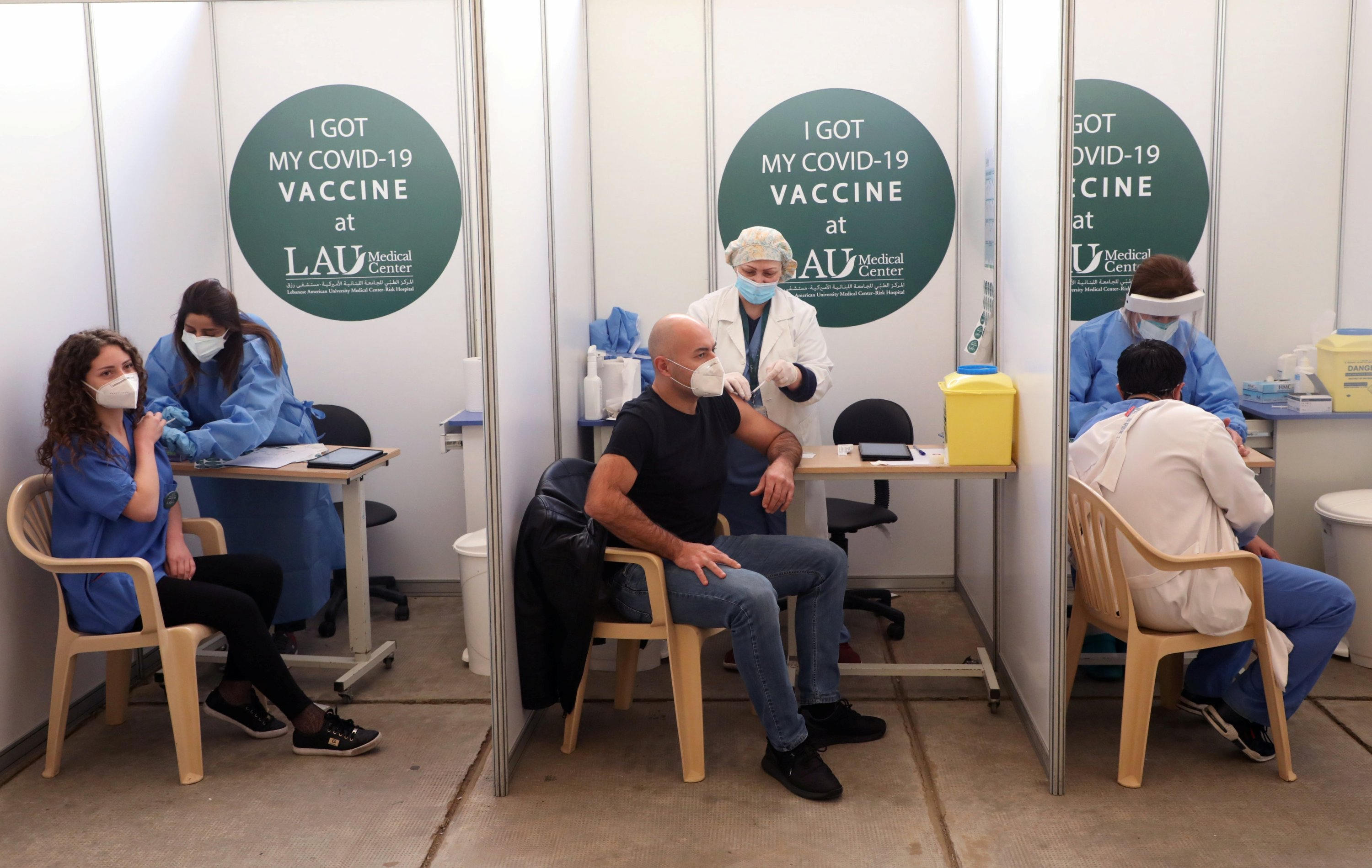 People receive a Pfizer-BioNTech COVID-19 vaccine dose during a coronavirus vaccination campaign at Lebanese American University Medical Center-Rizk Hospital in Beirut, Lebanon, Feb. 16, 2021. (REUTERS/Mohamed Azakir)