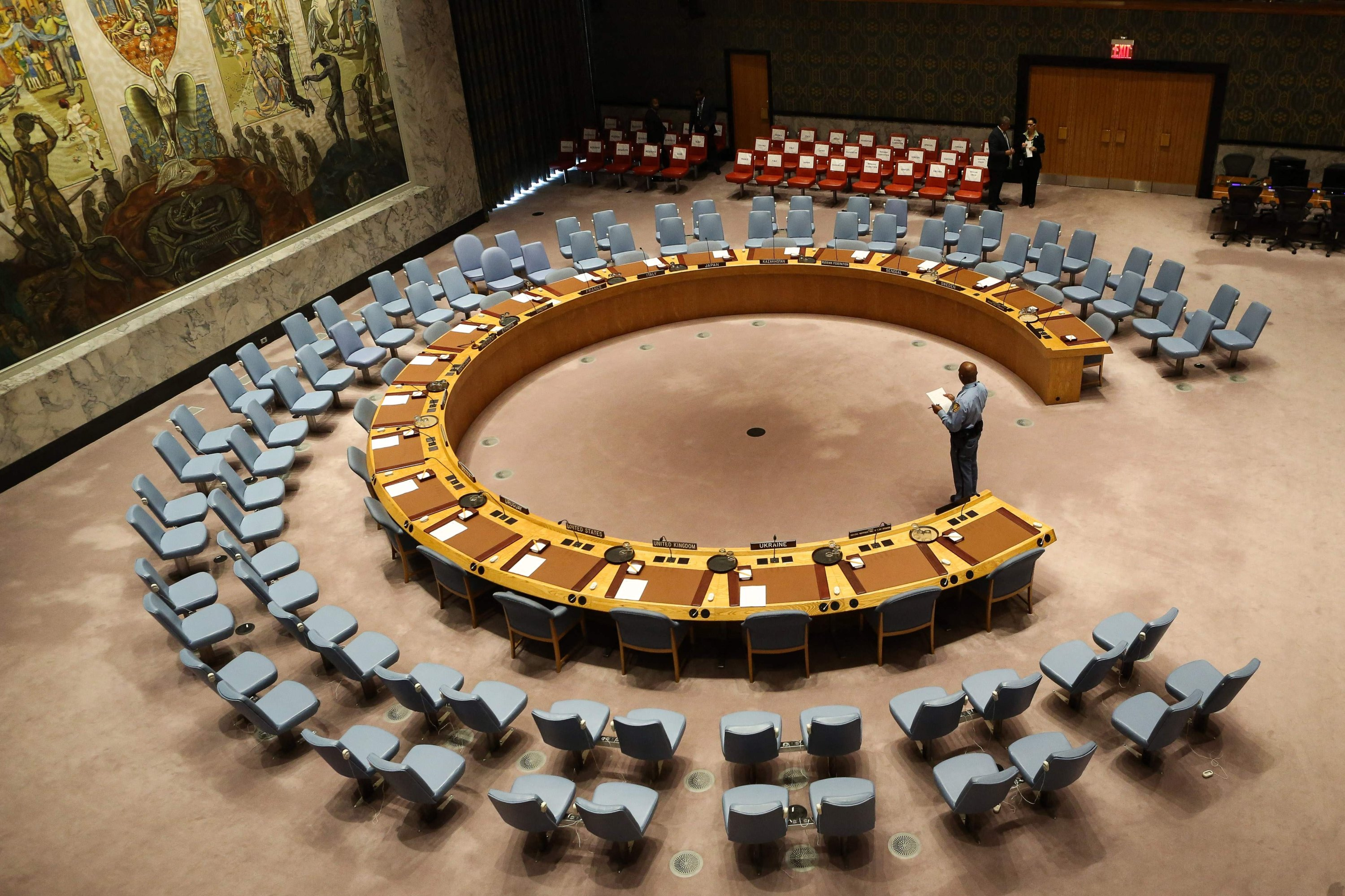 An official looks at the empty chairs of leaders ahead of their participation in an open debate of the United Nations Security Council in New York City,  on Sept. 20, 2017. (AFP Photo)